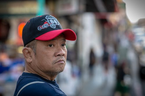 Free stock photo of asian, hat, looking back