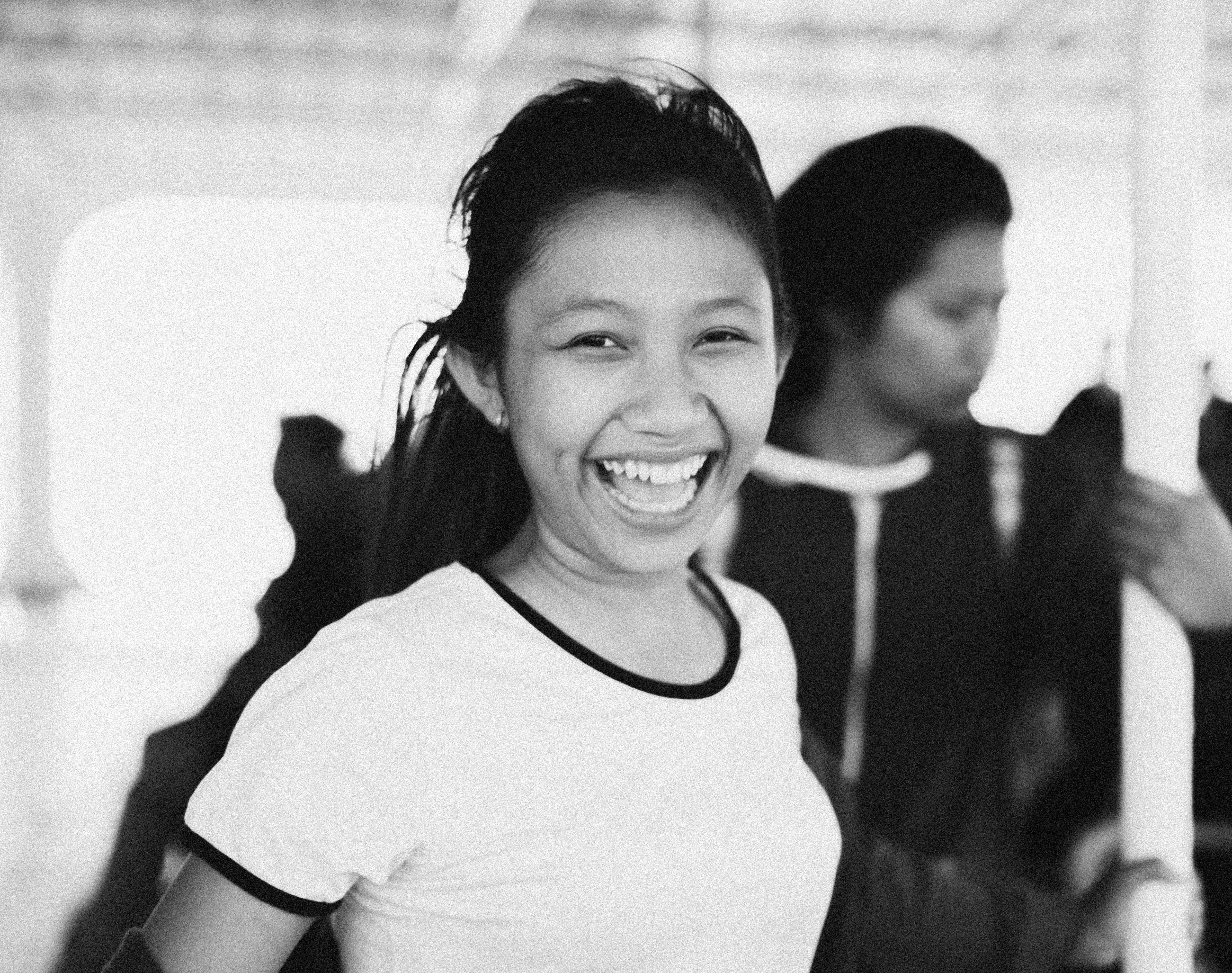 Grayscale Photography of Smiling Woman