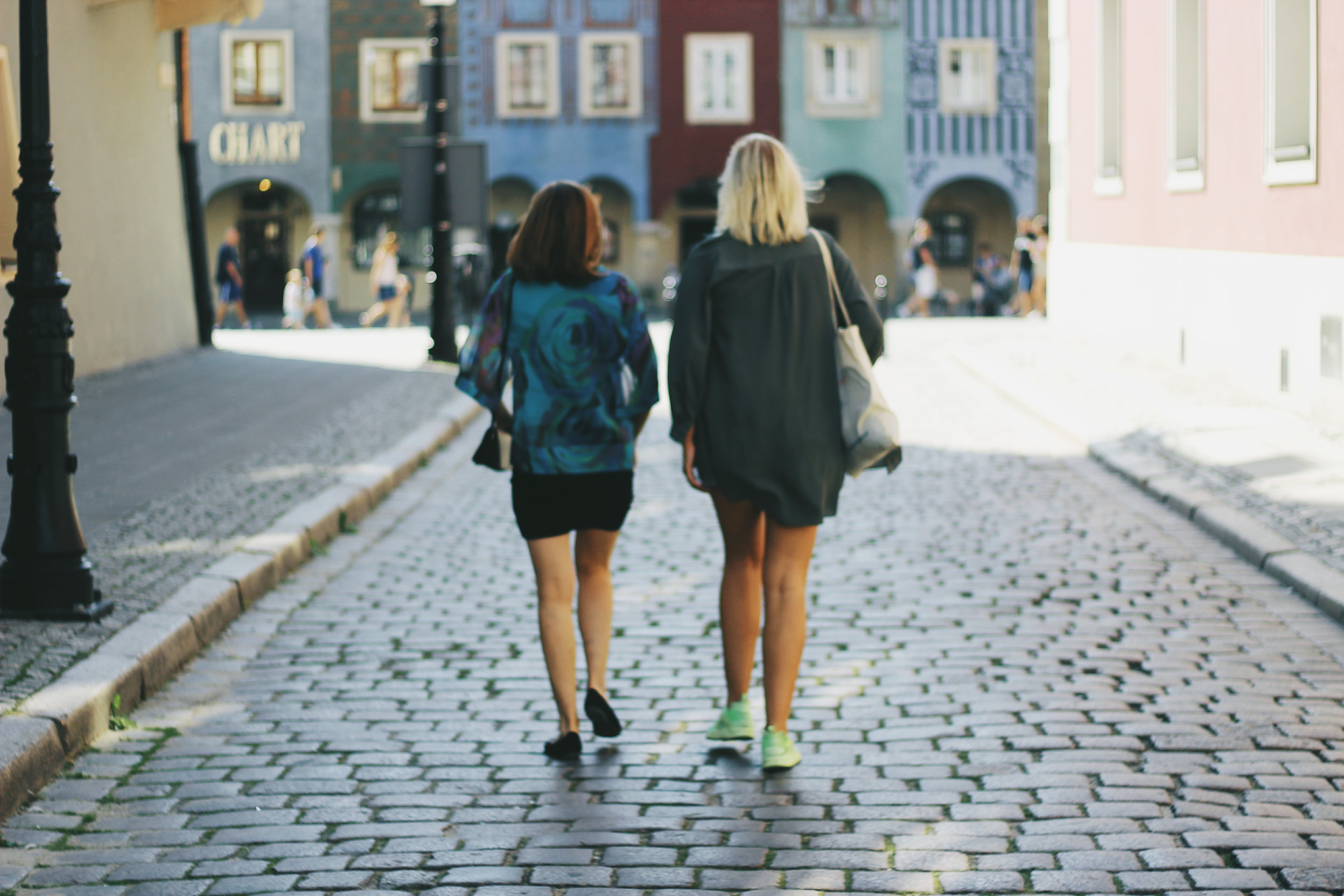 Two Women Walking on Street