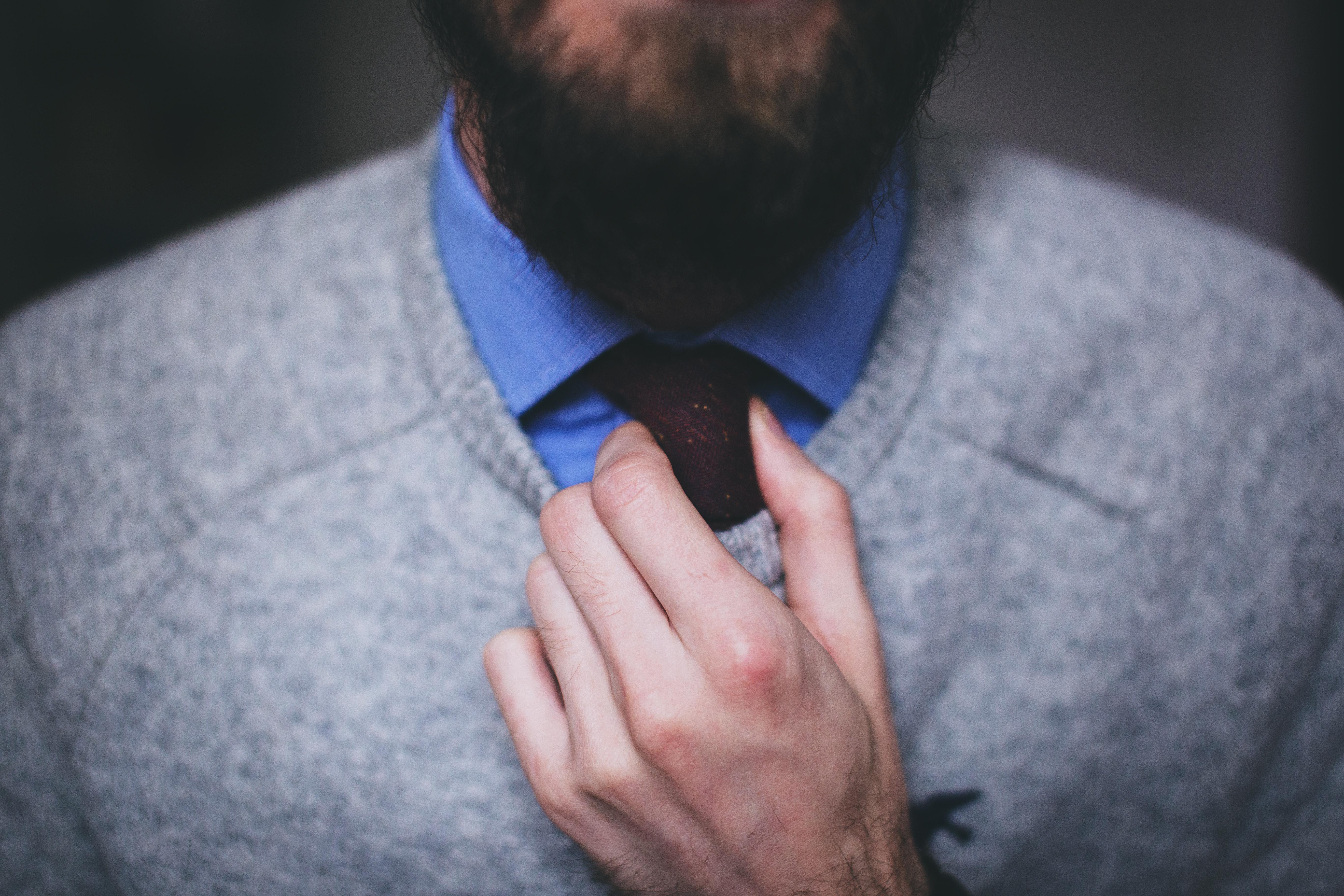 Man Wearing Gray Top Fixing Red Necktie