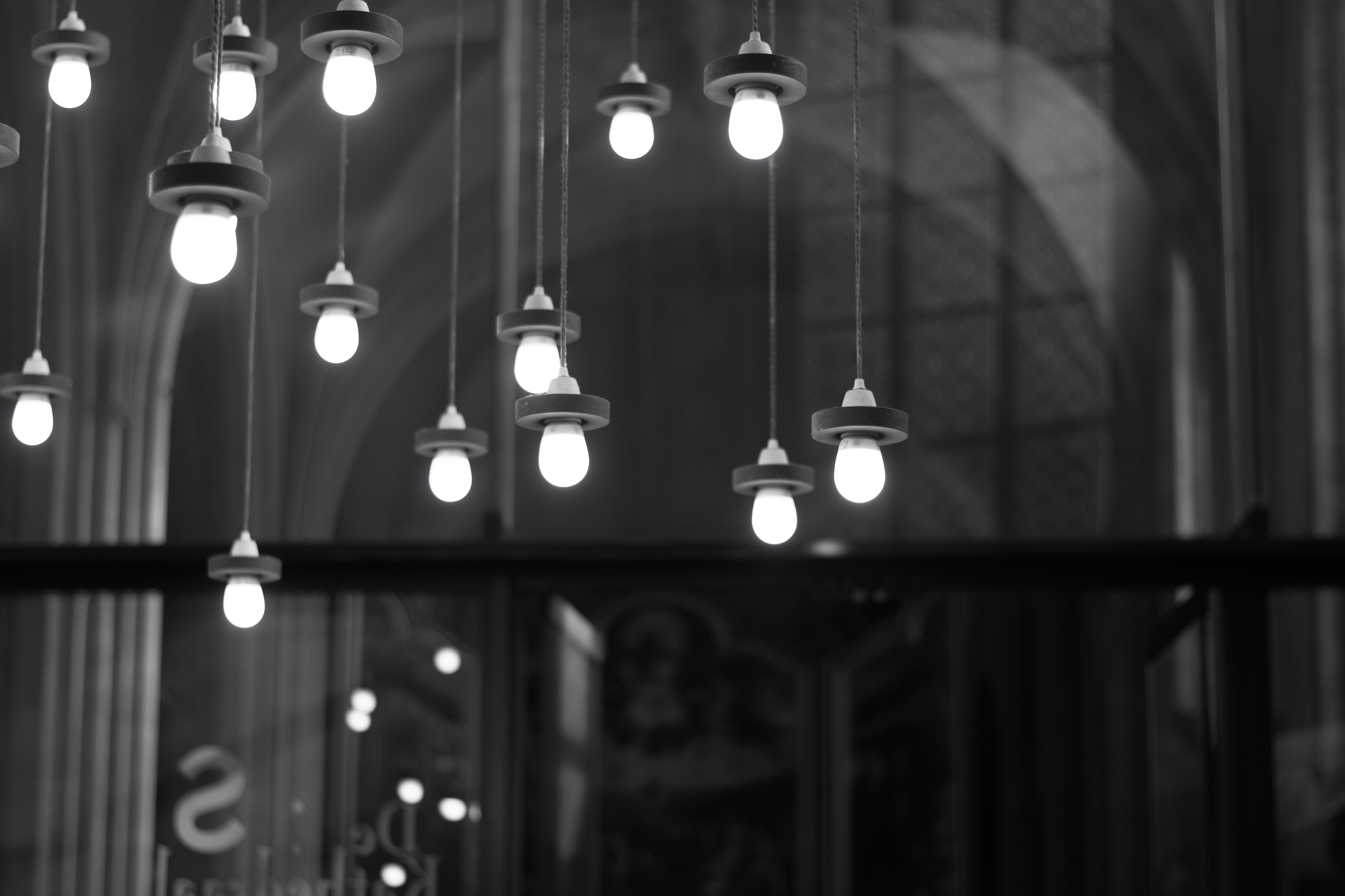 Grayscale Photography of Hanging Lights
