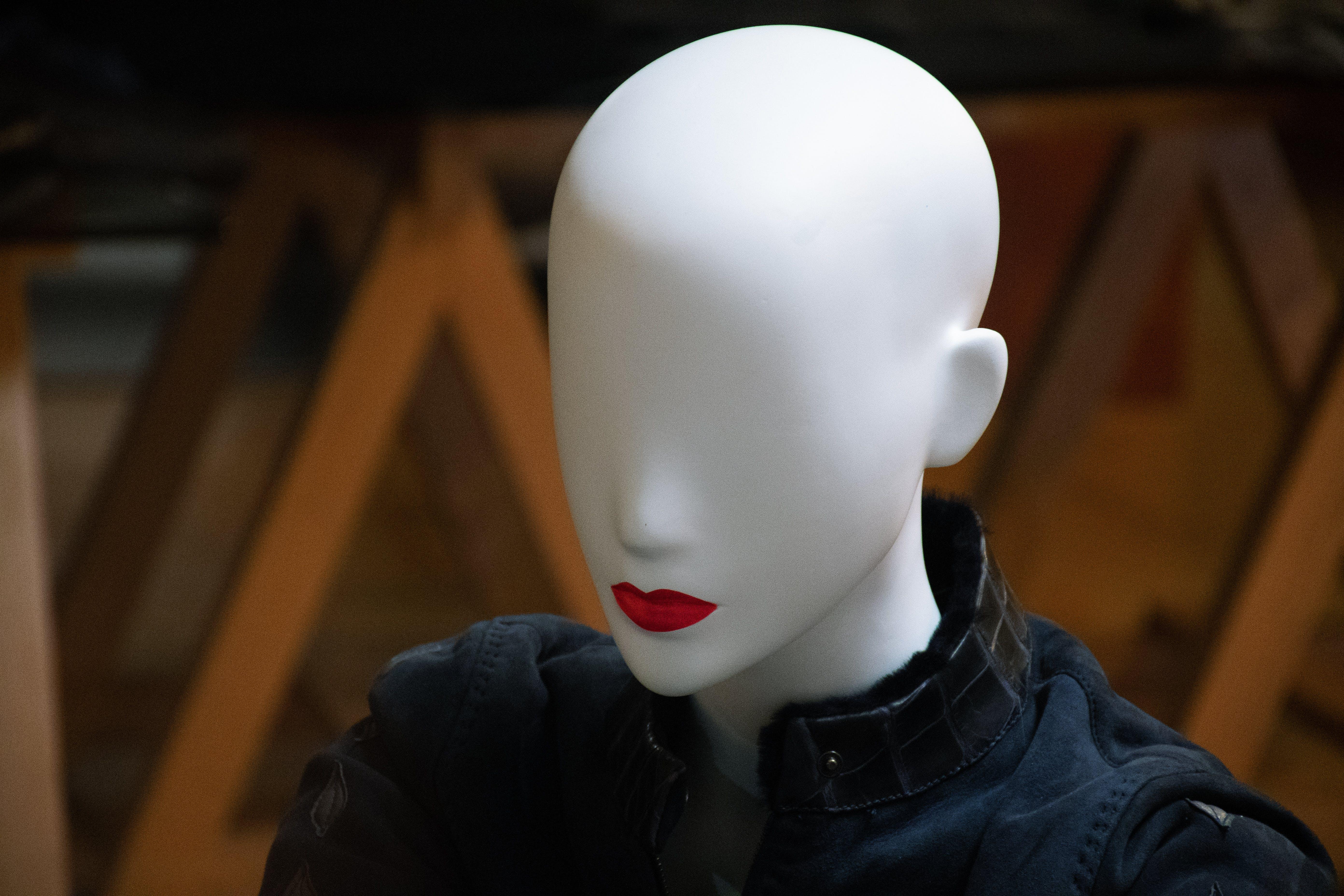 Female Mannequin Wearing Black Jacket