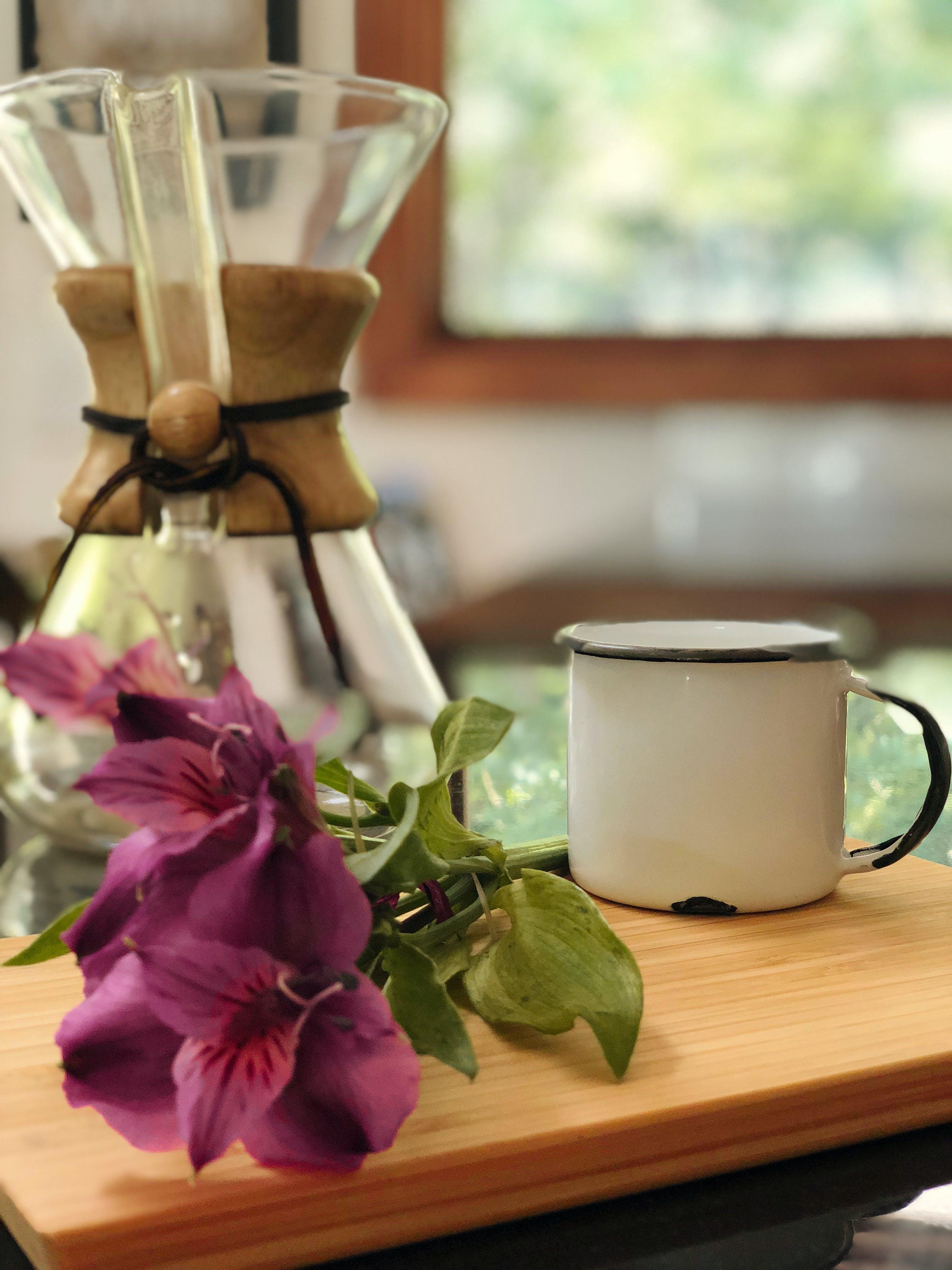 White Ceramic Mug on Brown Table