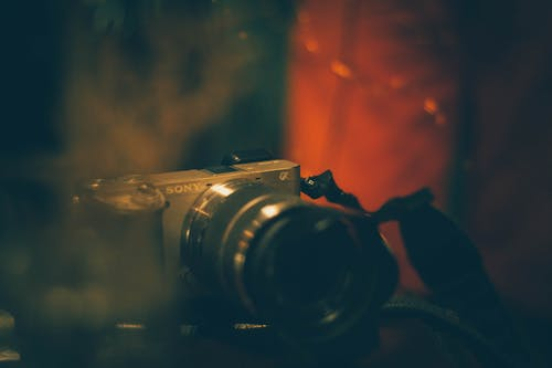 Shallow Focus Photography of Sony Dslr Camera on Table