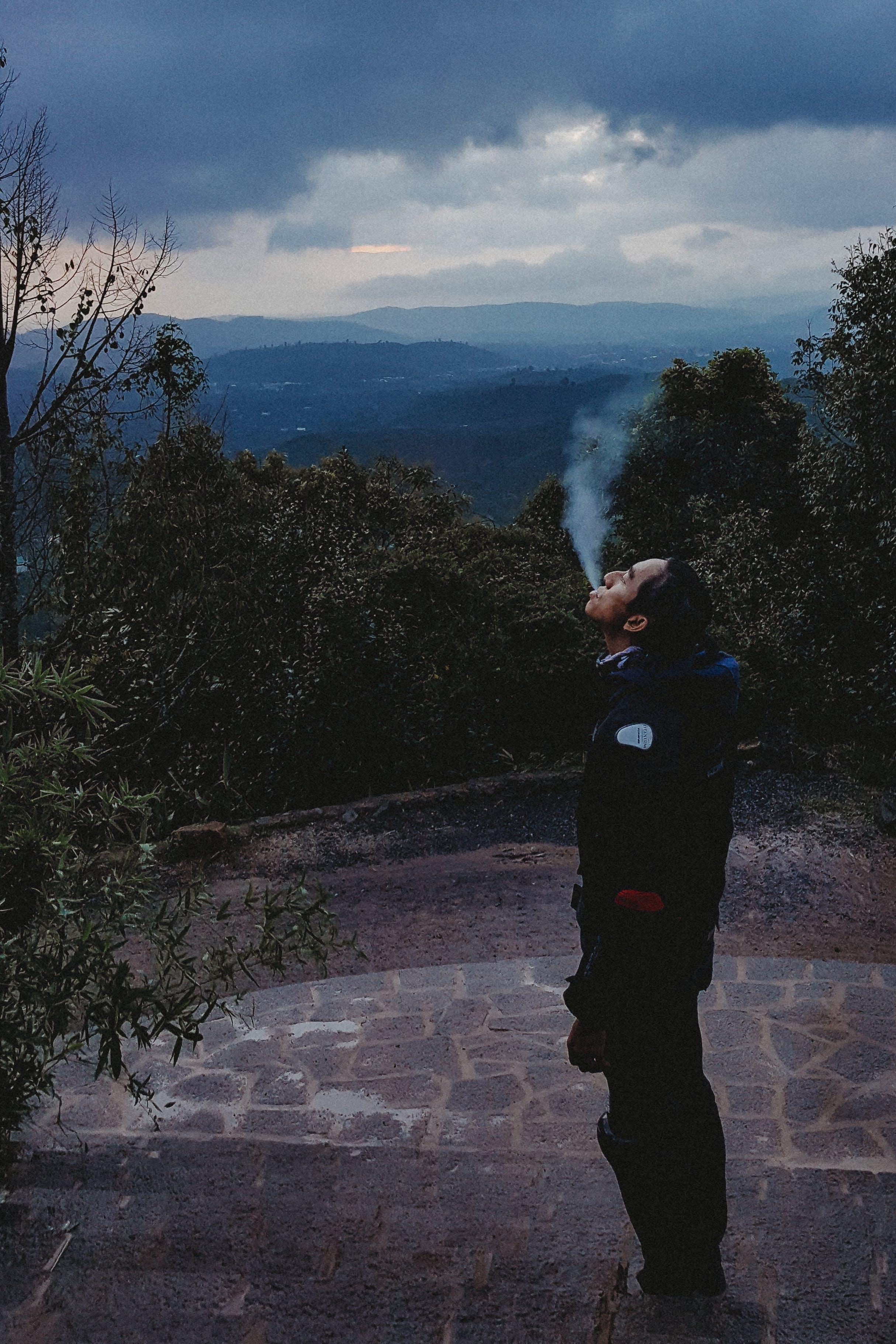Man Smoking Looking Up