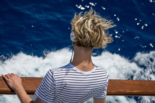 Close-Up Photography of Man Looking Down the Sea