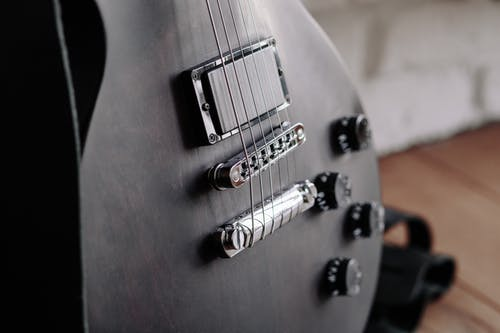 Close-Up Photo of Black Electric Guitar