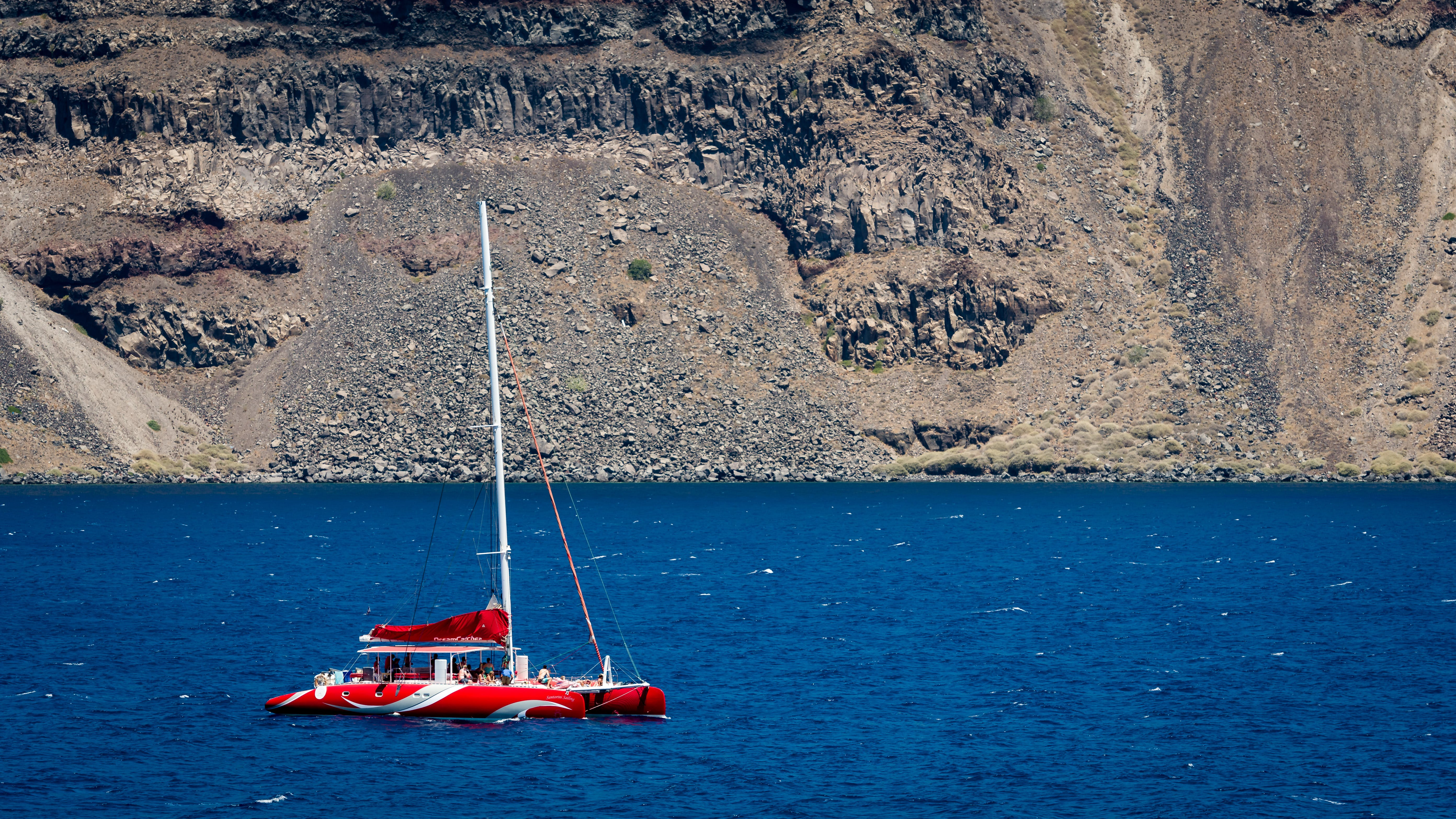 Photography of Red Sailing Boat on Sea