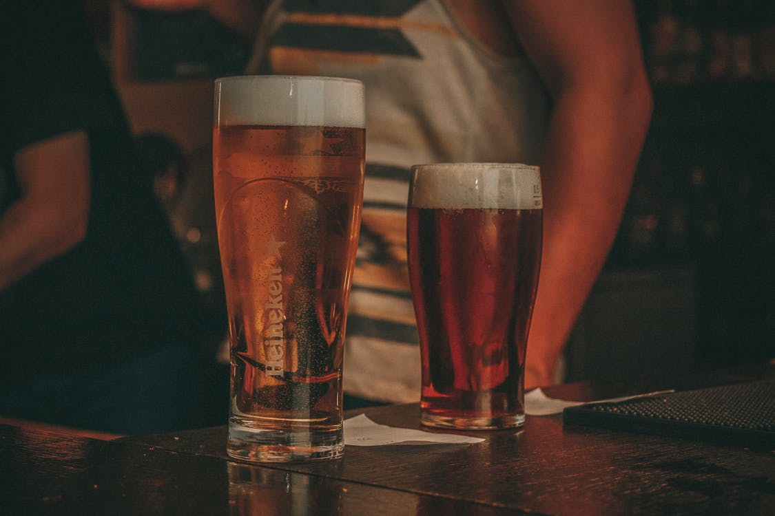 Two Clear Drinking Glass Filled With Beer