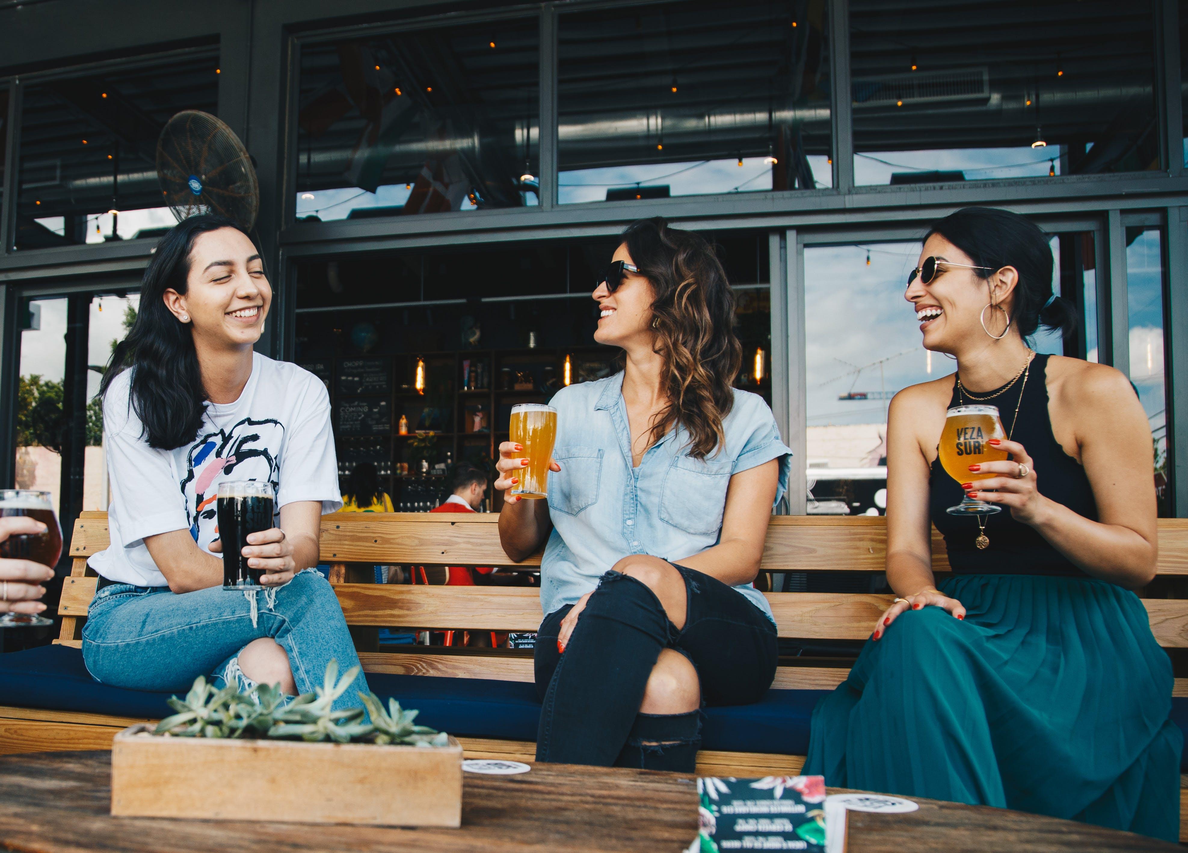 Three Women Sitting on Bench