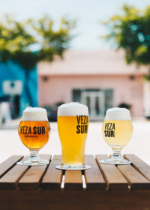 Three Veza Sur Glass Cup Filled With Beers