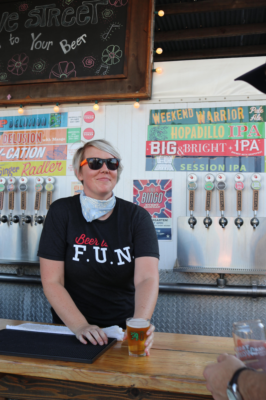 Man Wearing Black Sunglasses Holding Clear Beer Mug Inside Bar Counter