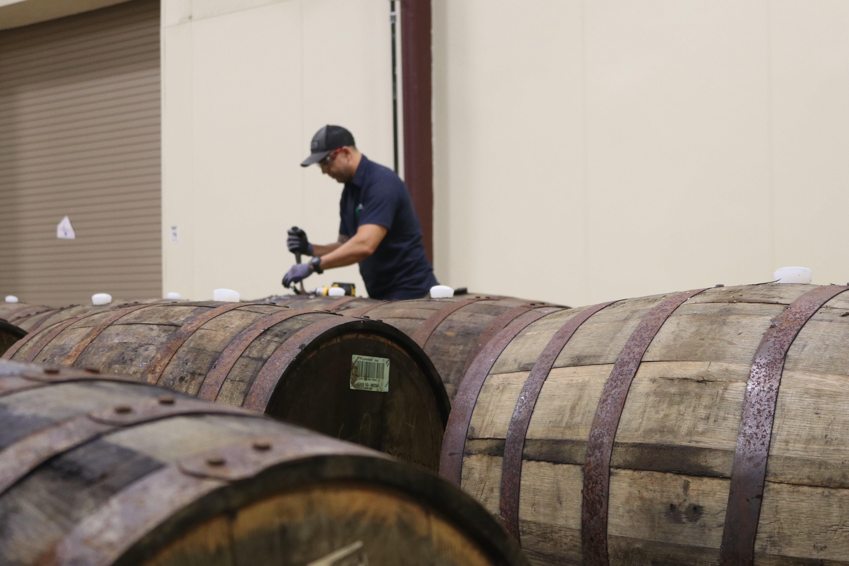 Man Fixing Barrel