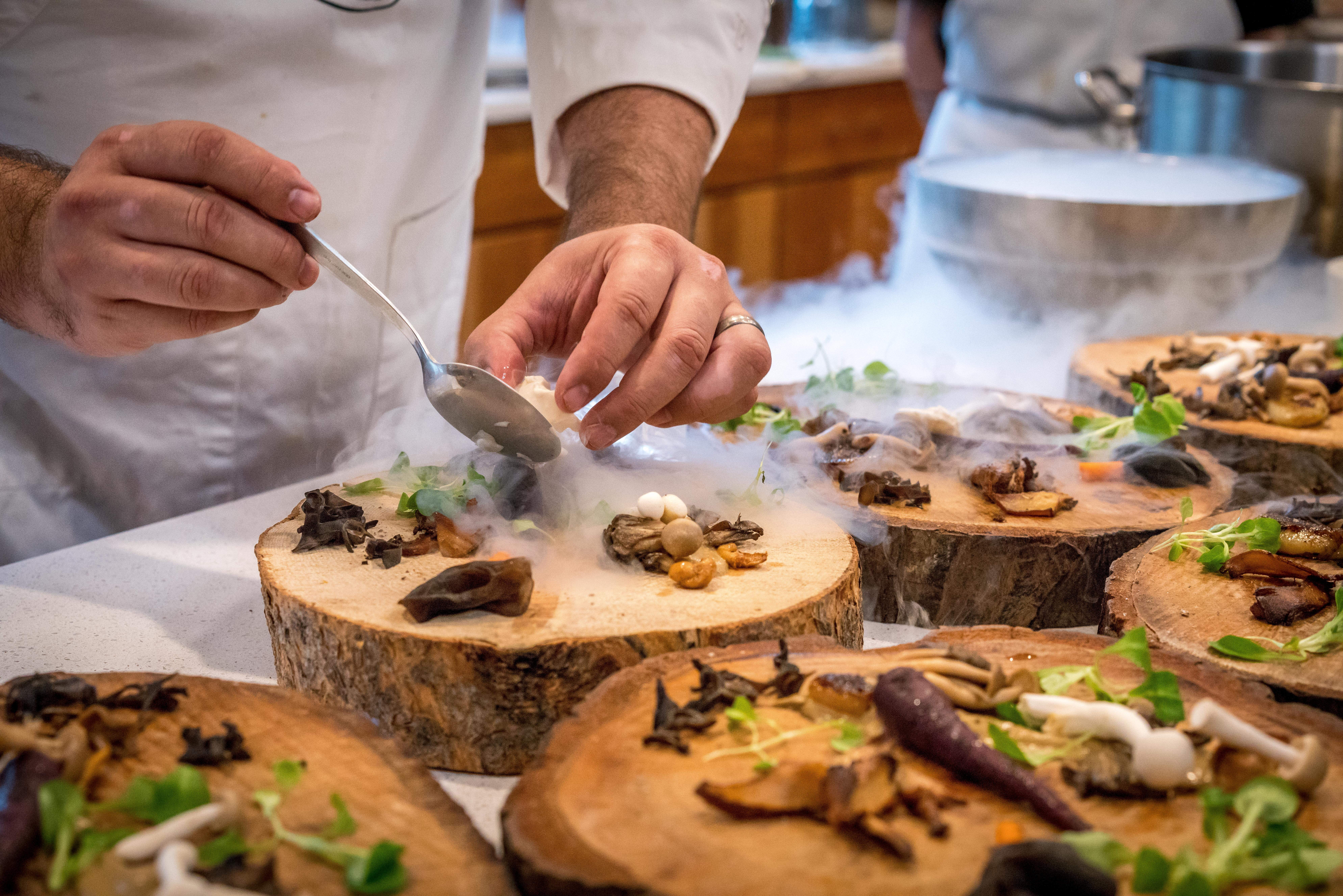 Chef Preparing Vegetable Dish on Tree Slab