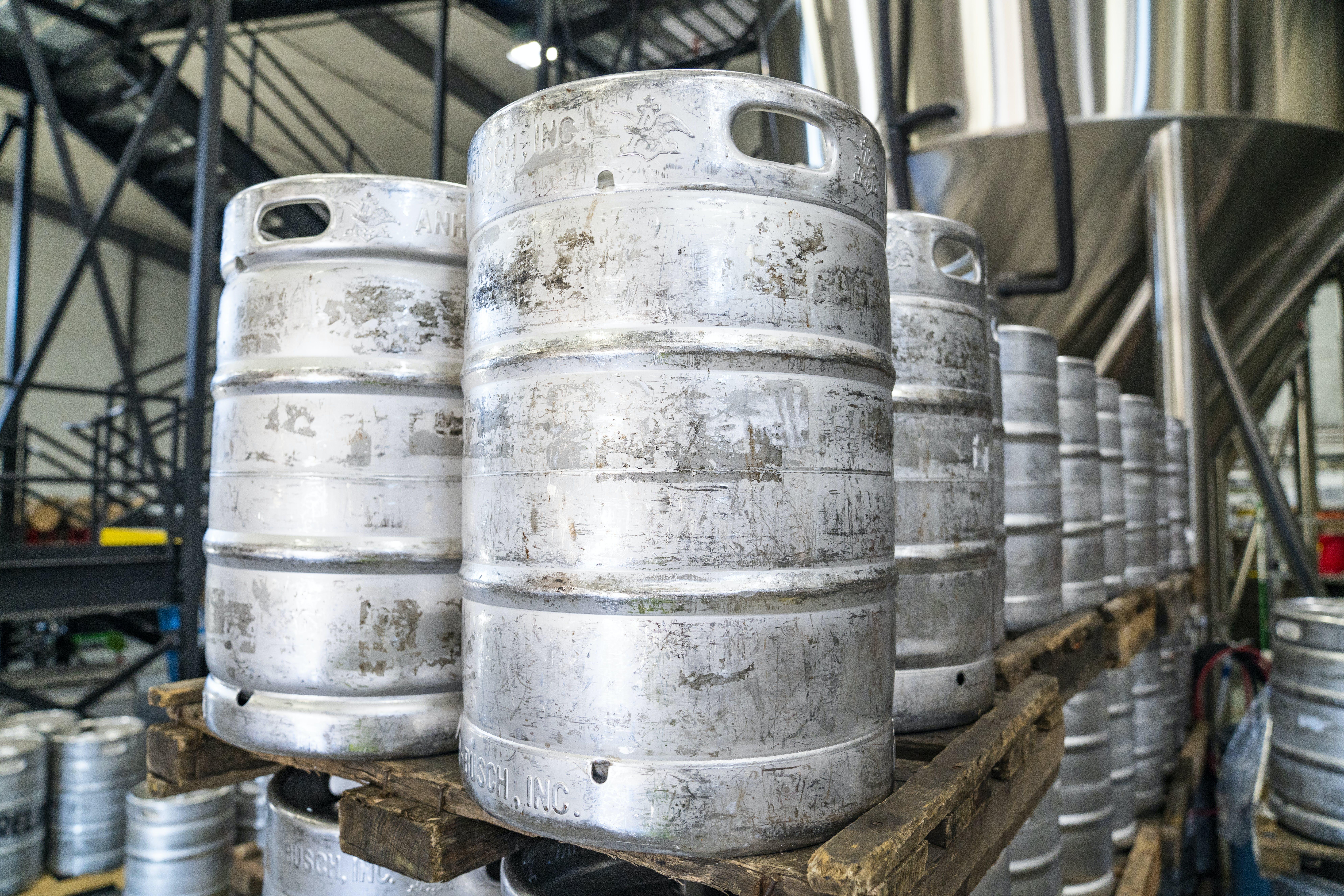 Pile of Gray Metal Drumt Inside Factory