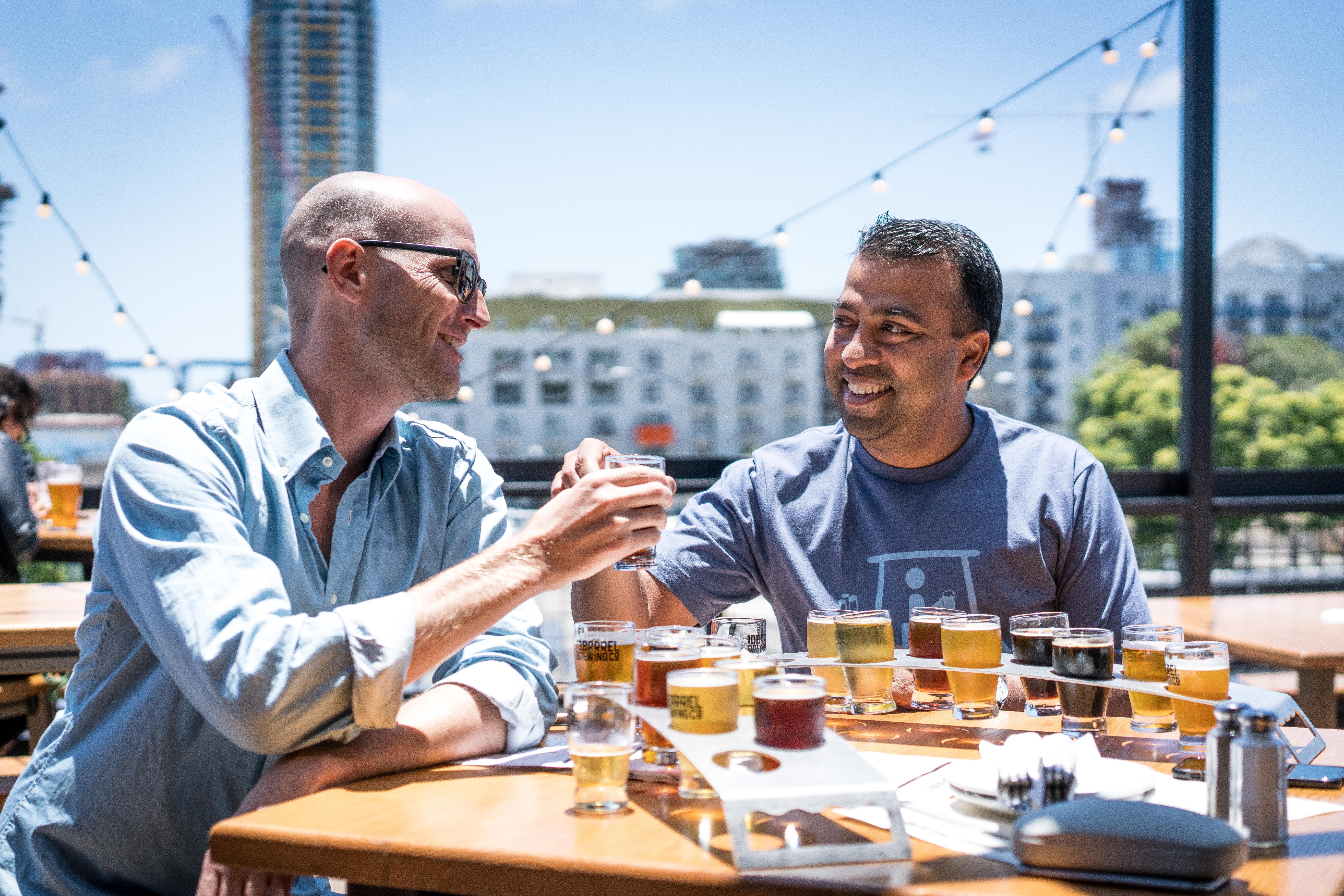 Two Men Drinking Outside Restaurant