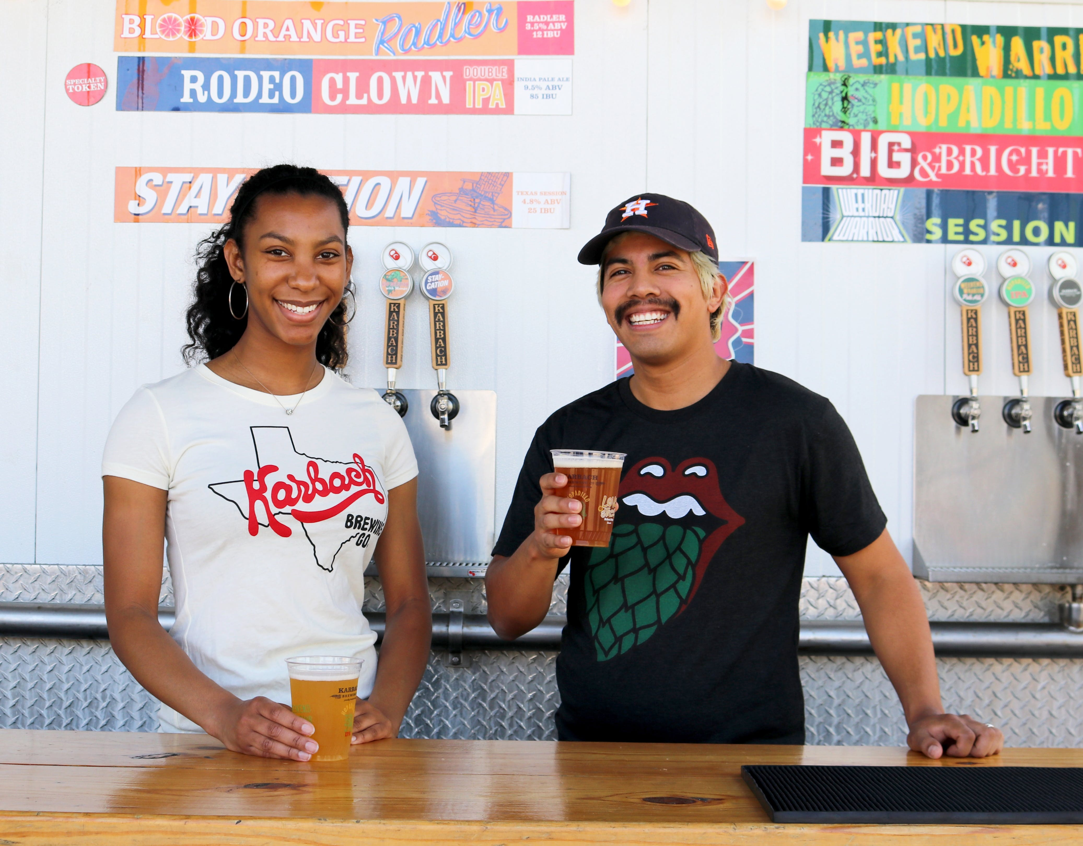 Man and Woman Smiling While Drinking Beers