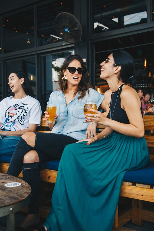 Women Sitting on Bench Restaurant