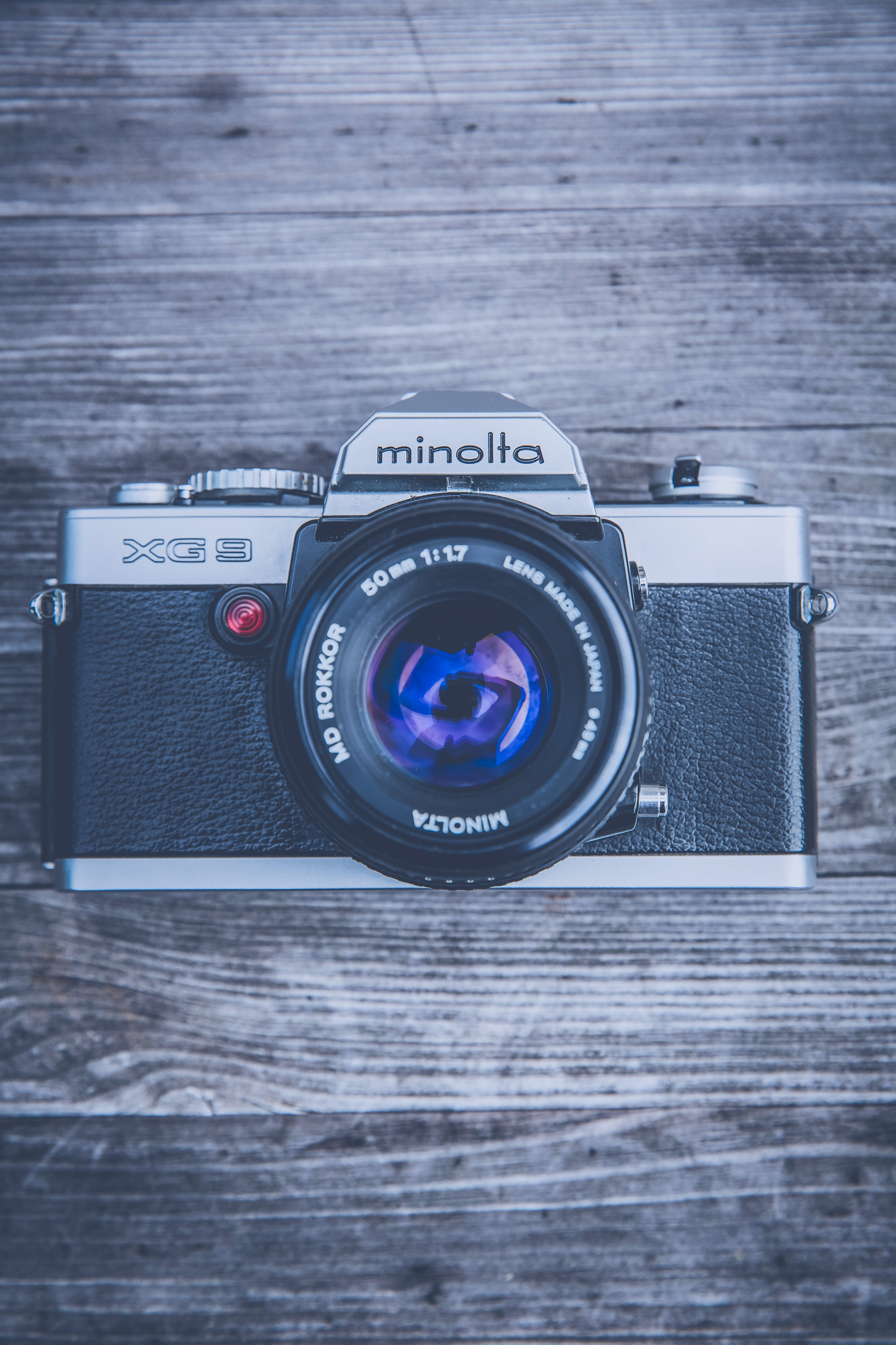 Silver and Black Minolta Camera in Close Up Photography