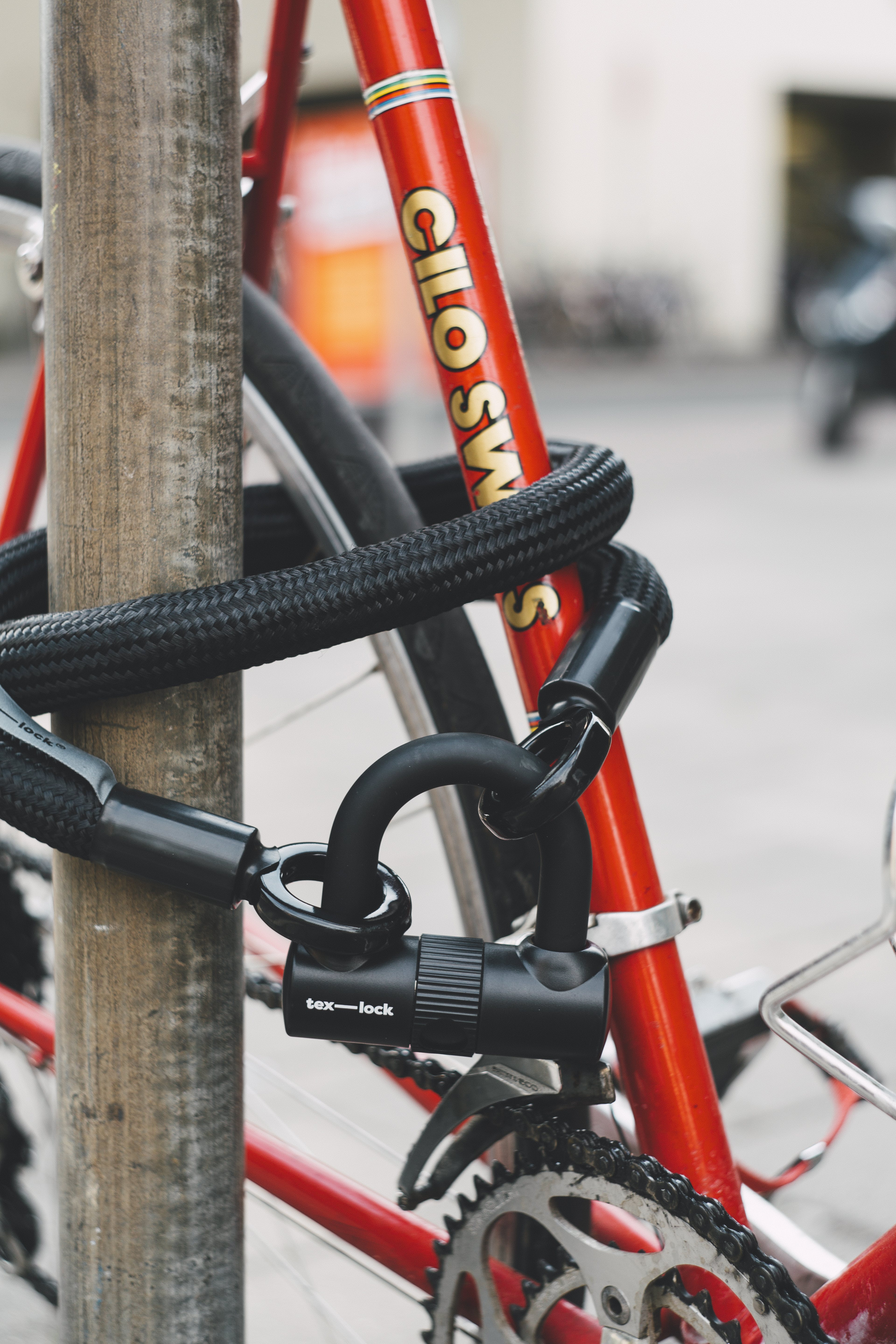 Red Bicycle With Black Lex-lock Cable