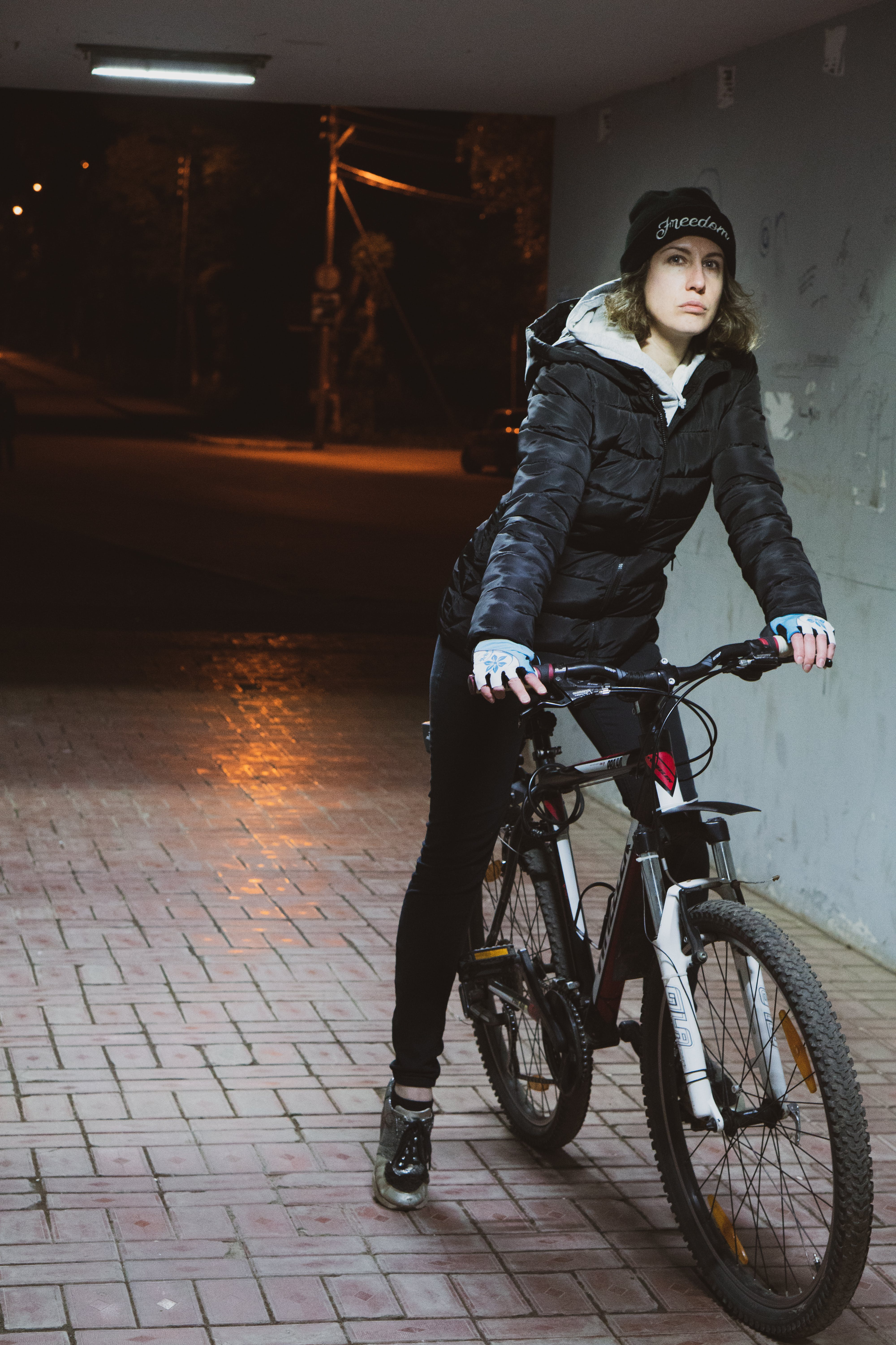 Woman Wearing Black Coat Riding on Her Bicycle