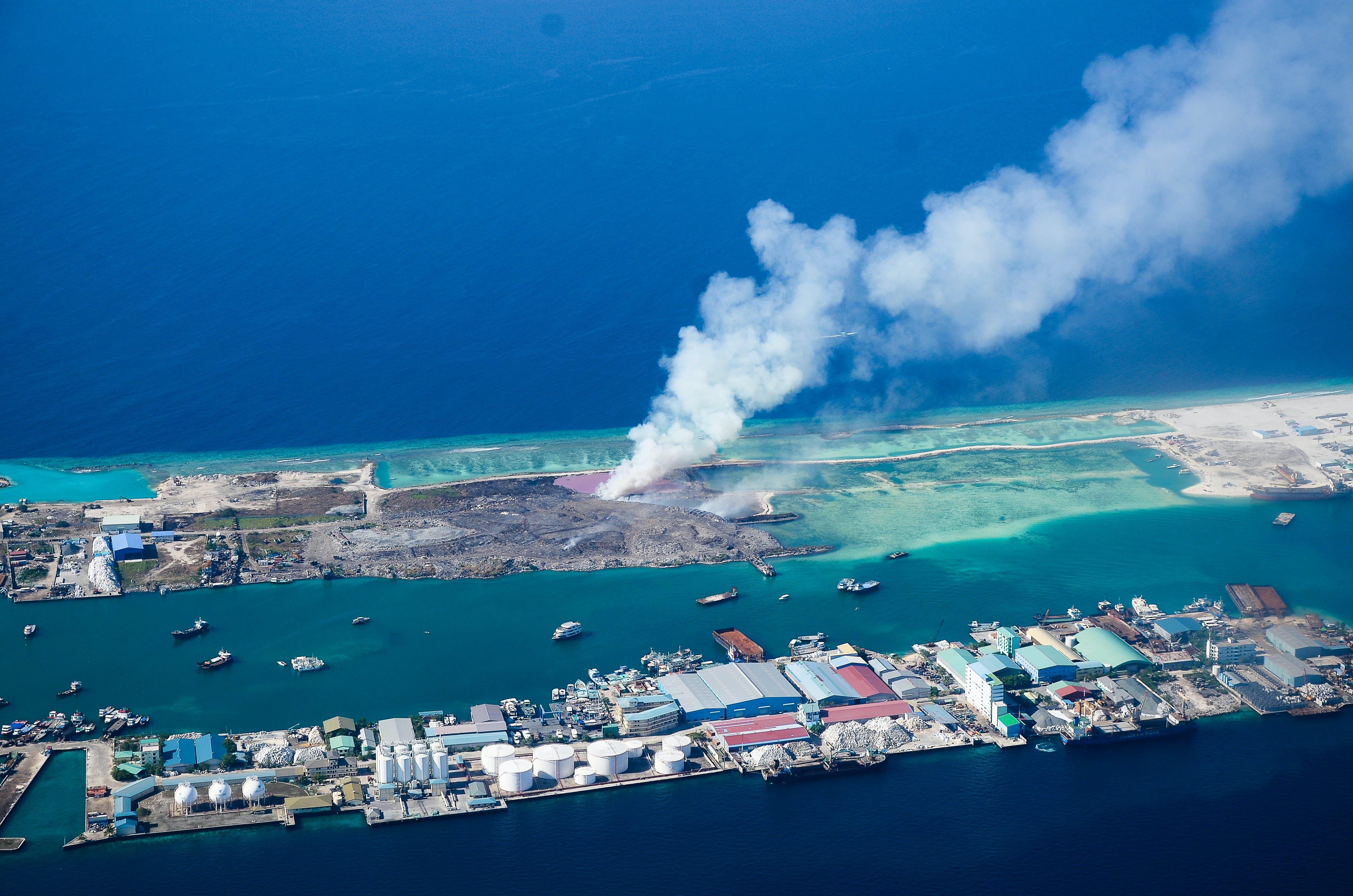 Aerial View of Land Blowing Smoke