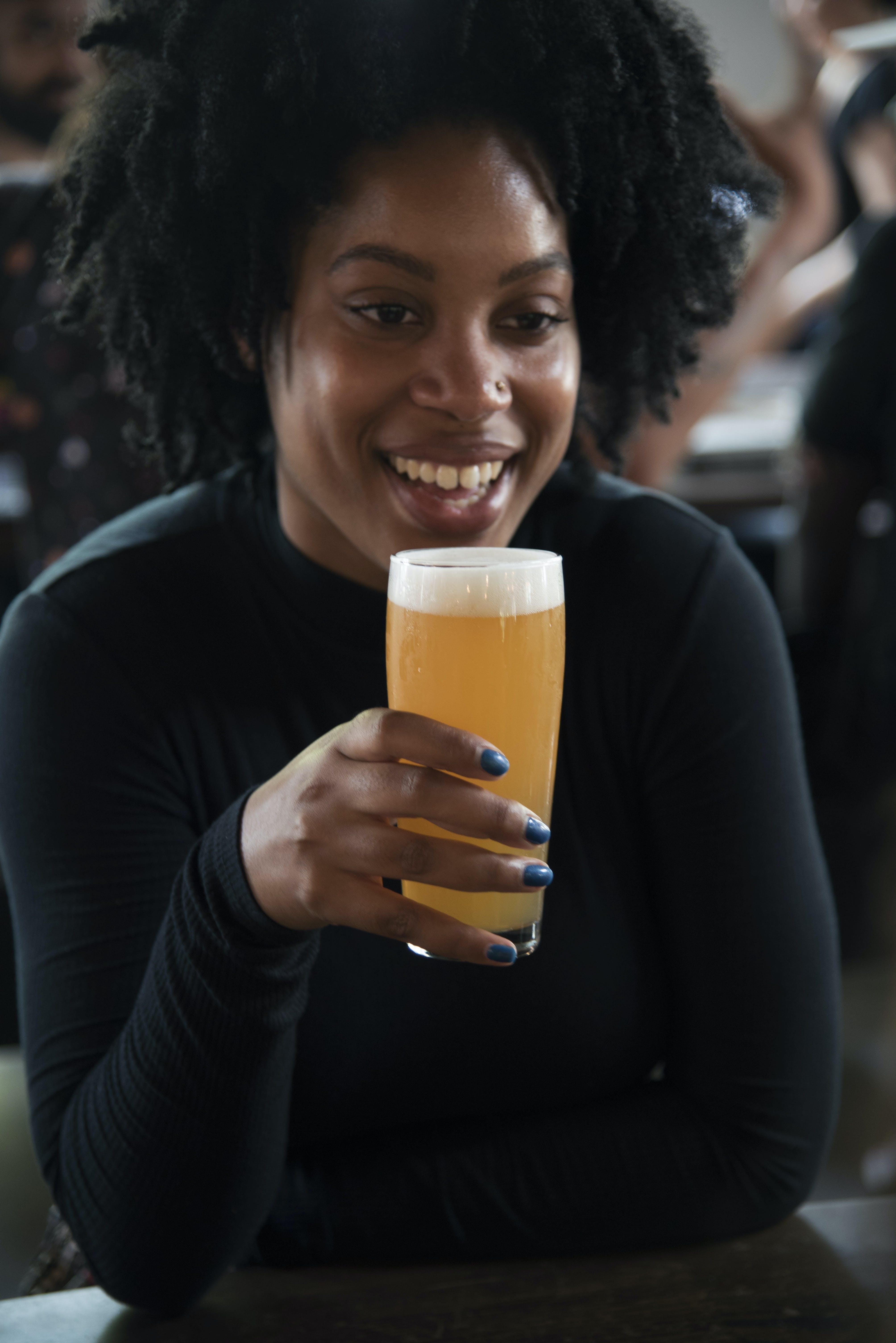 Woman Holding Beer Mug