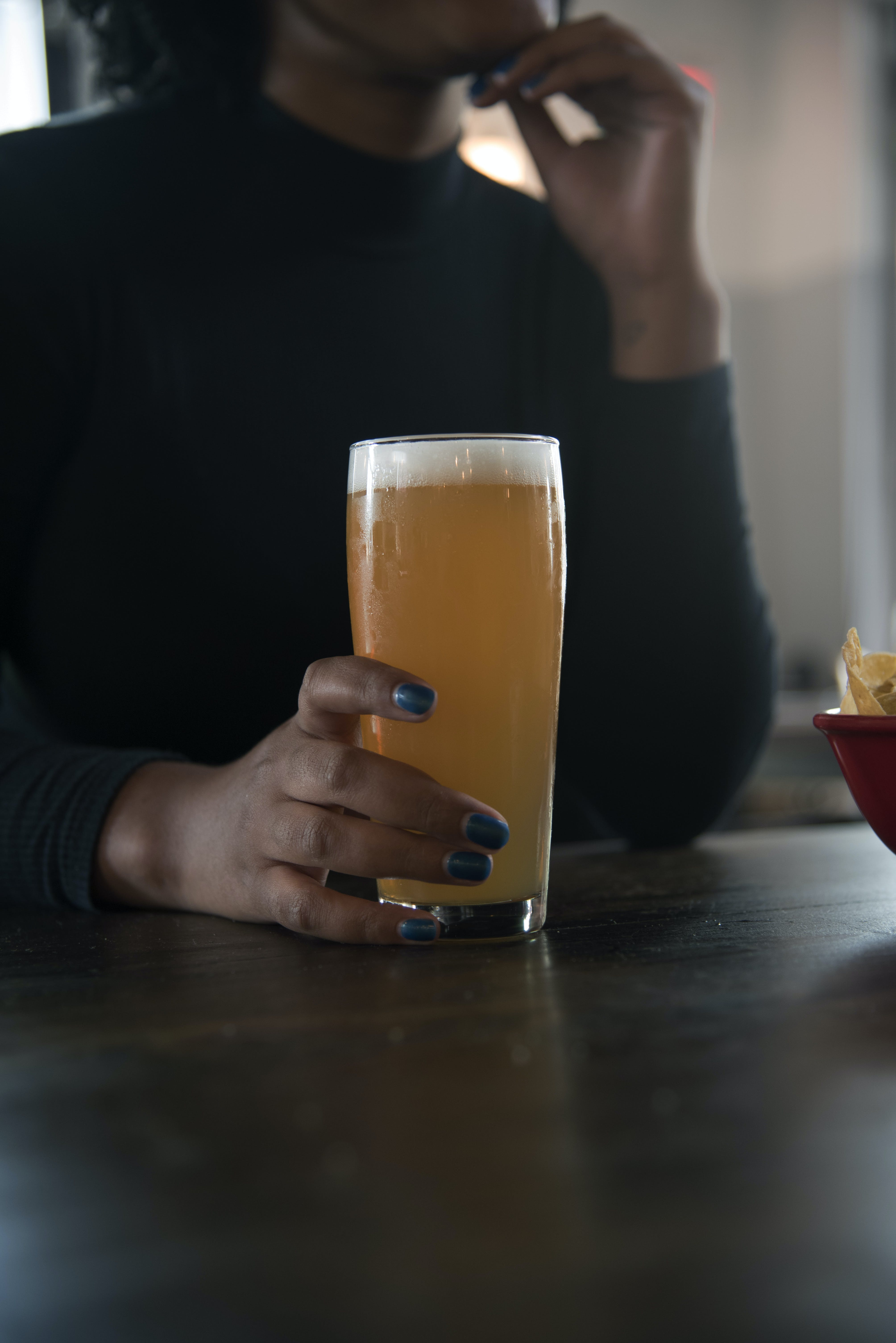 Person Holding Drinking Glass With Beer