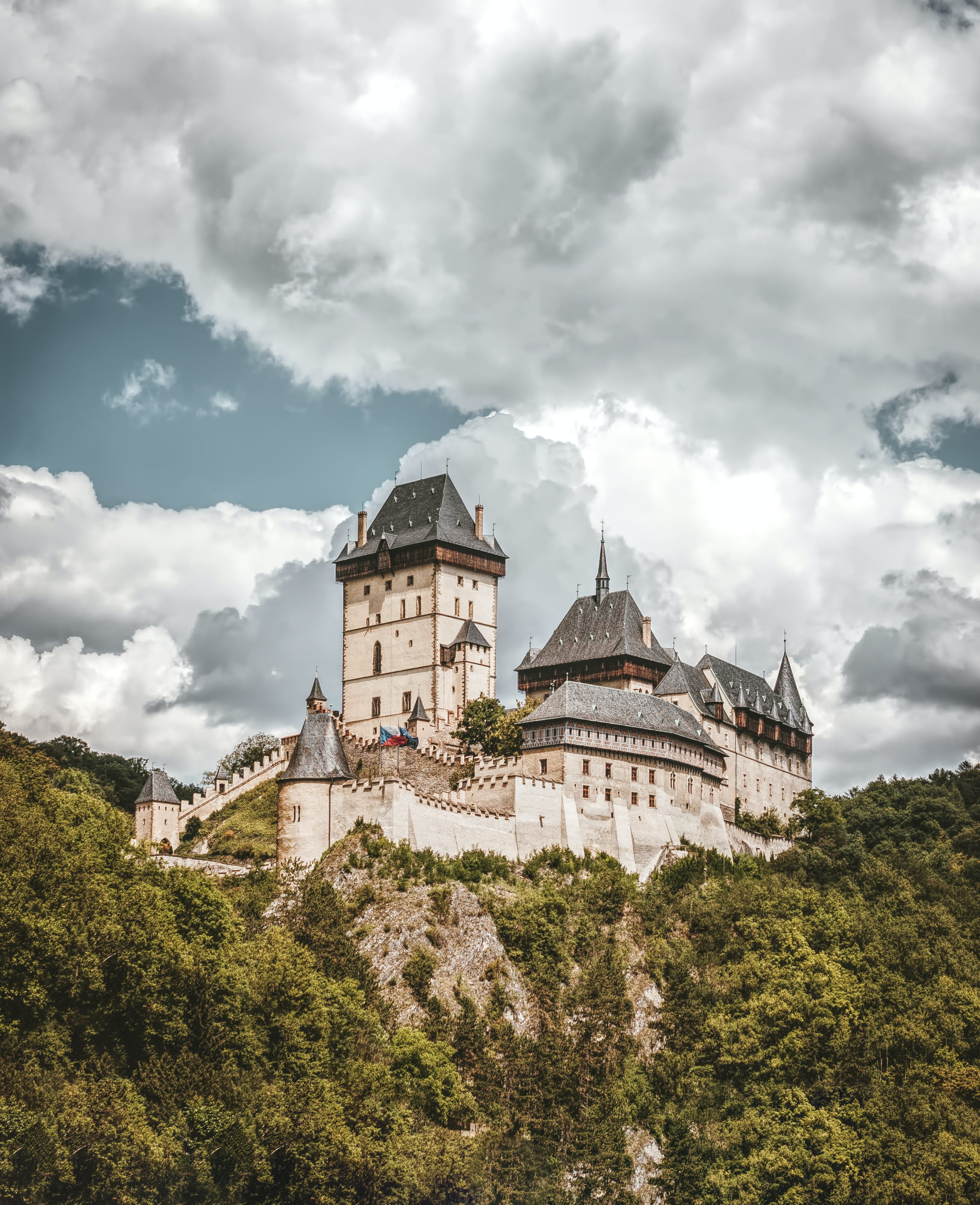 White and Black Concrete Castle on Mountain Under White Clouds