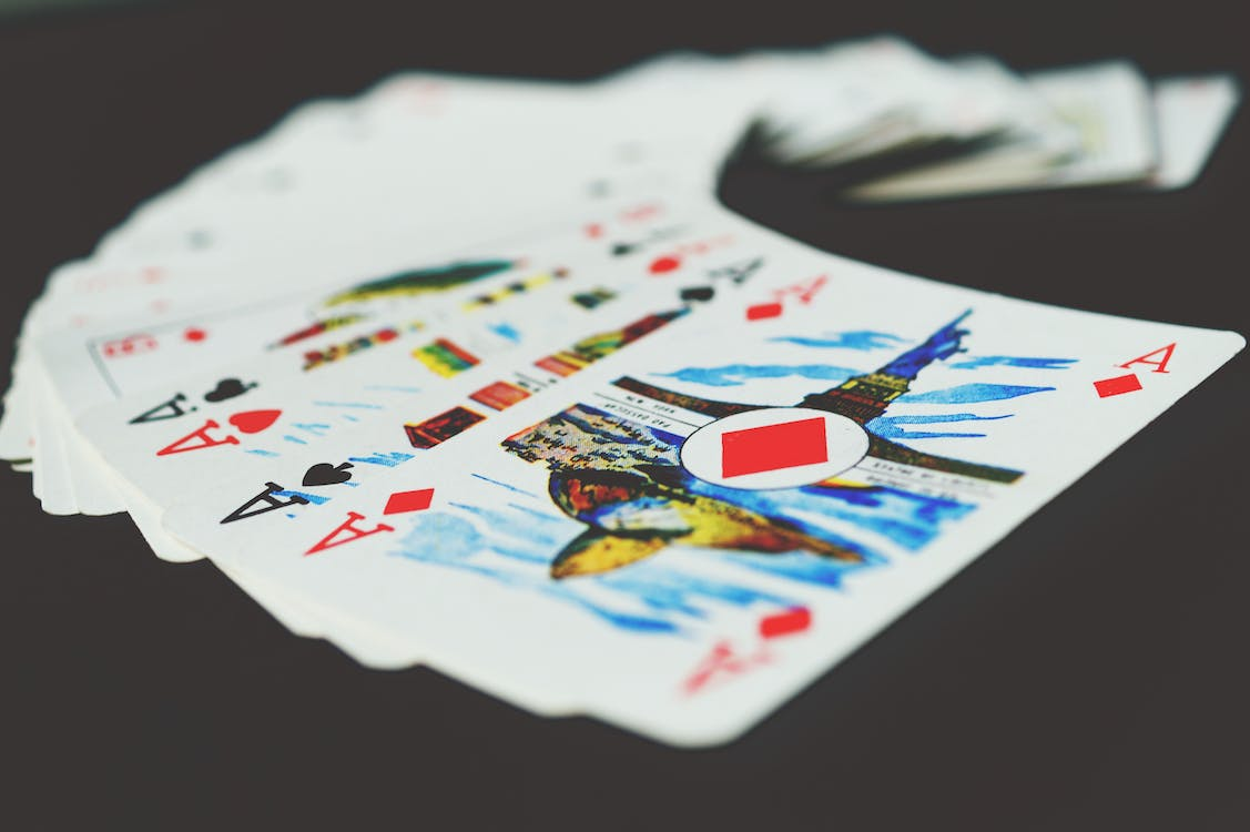 Playing Cards on Black Surface