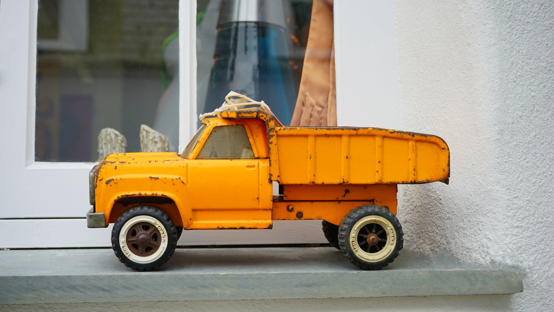 Free stock photo of yellow, vehicle, window, toy