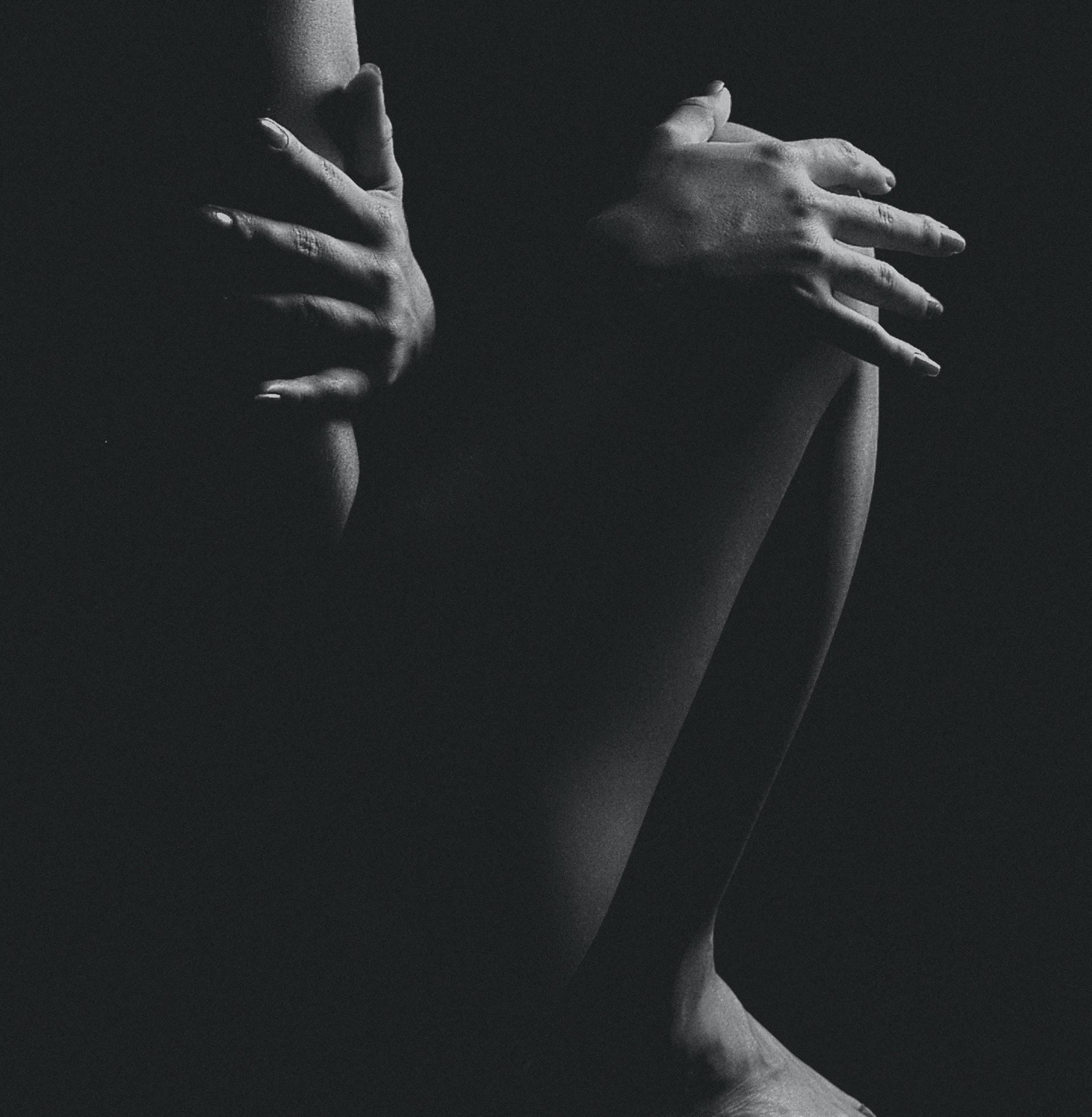 Grayscale Photo of Naked Woman in a Dark Room