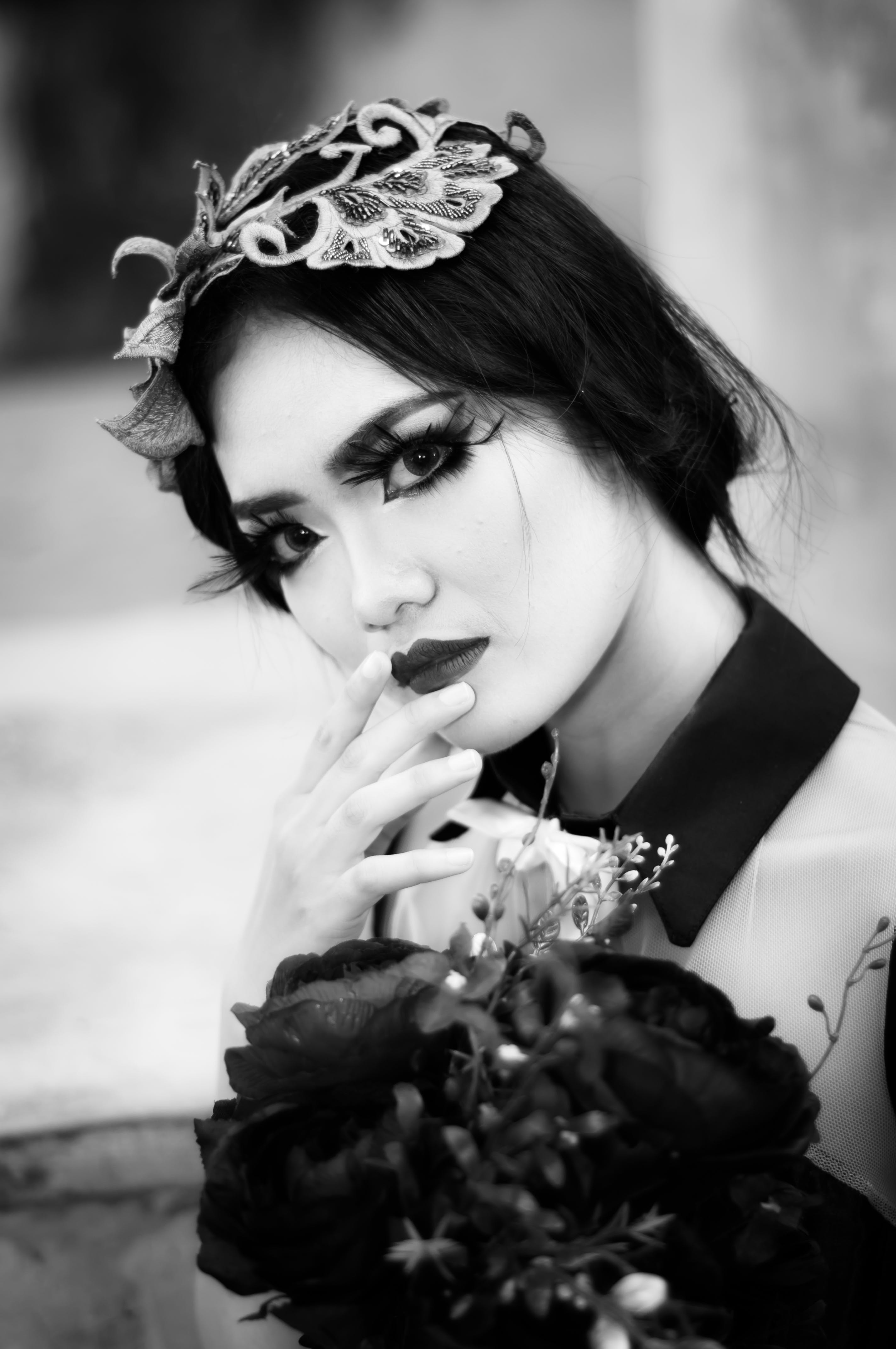 Grayscale Photo of Woman With Flowers