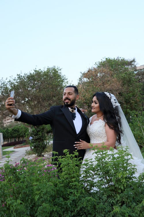 Bridal Couple Taking Selfie