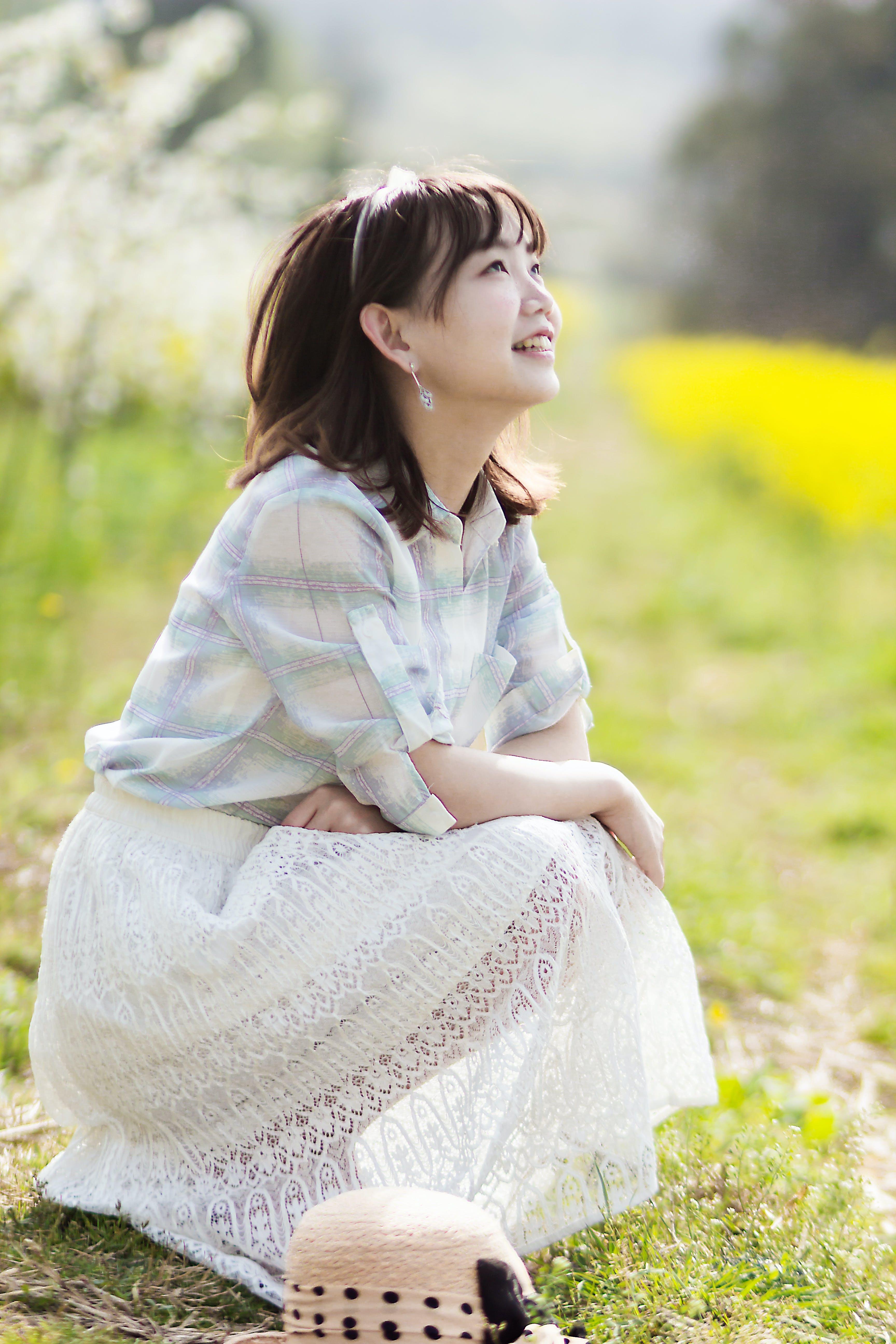 Woman Sitting Near Grass