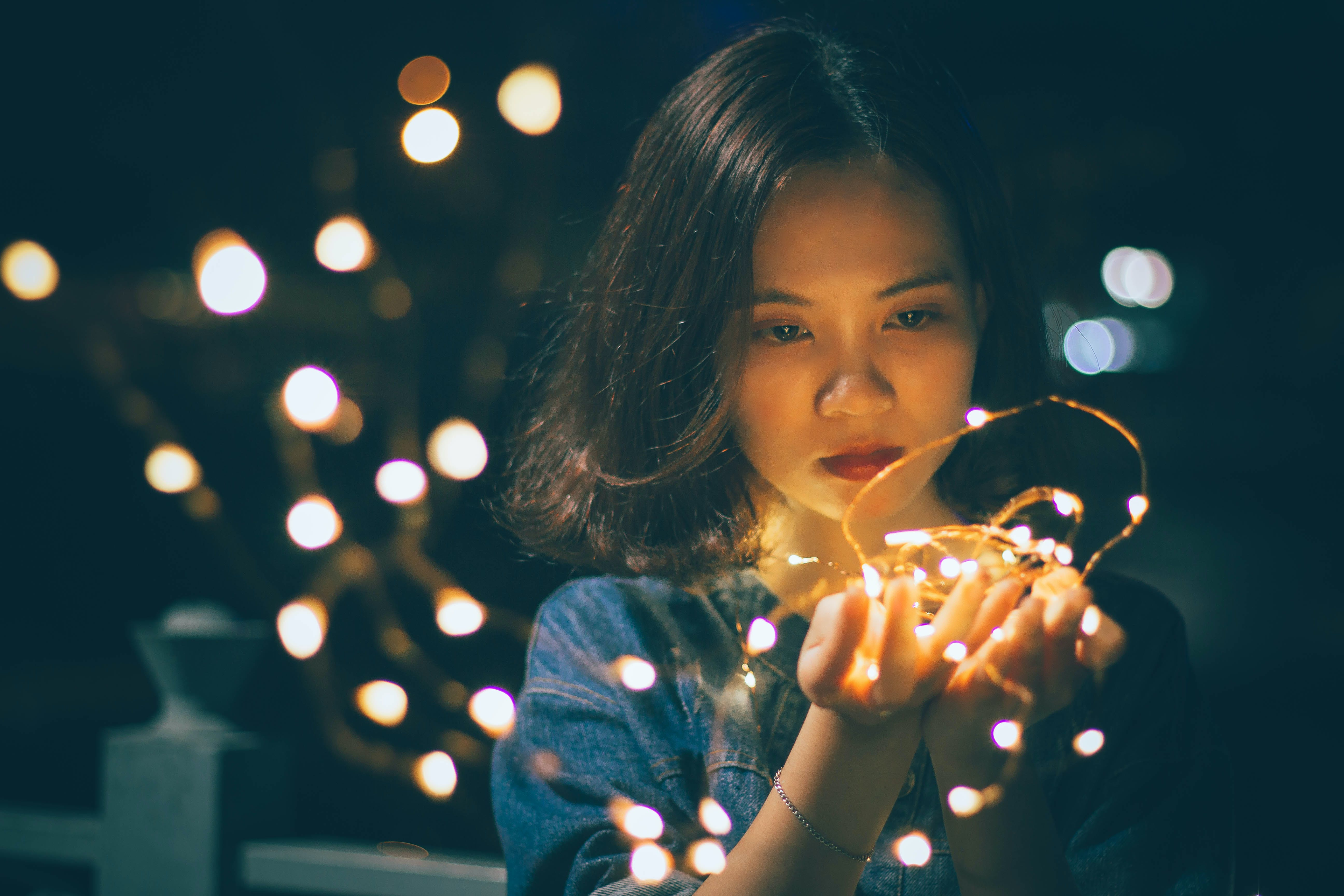 Close-Up Photography of Woman Holding Sting Lights