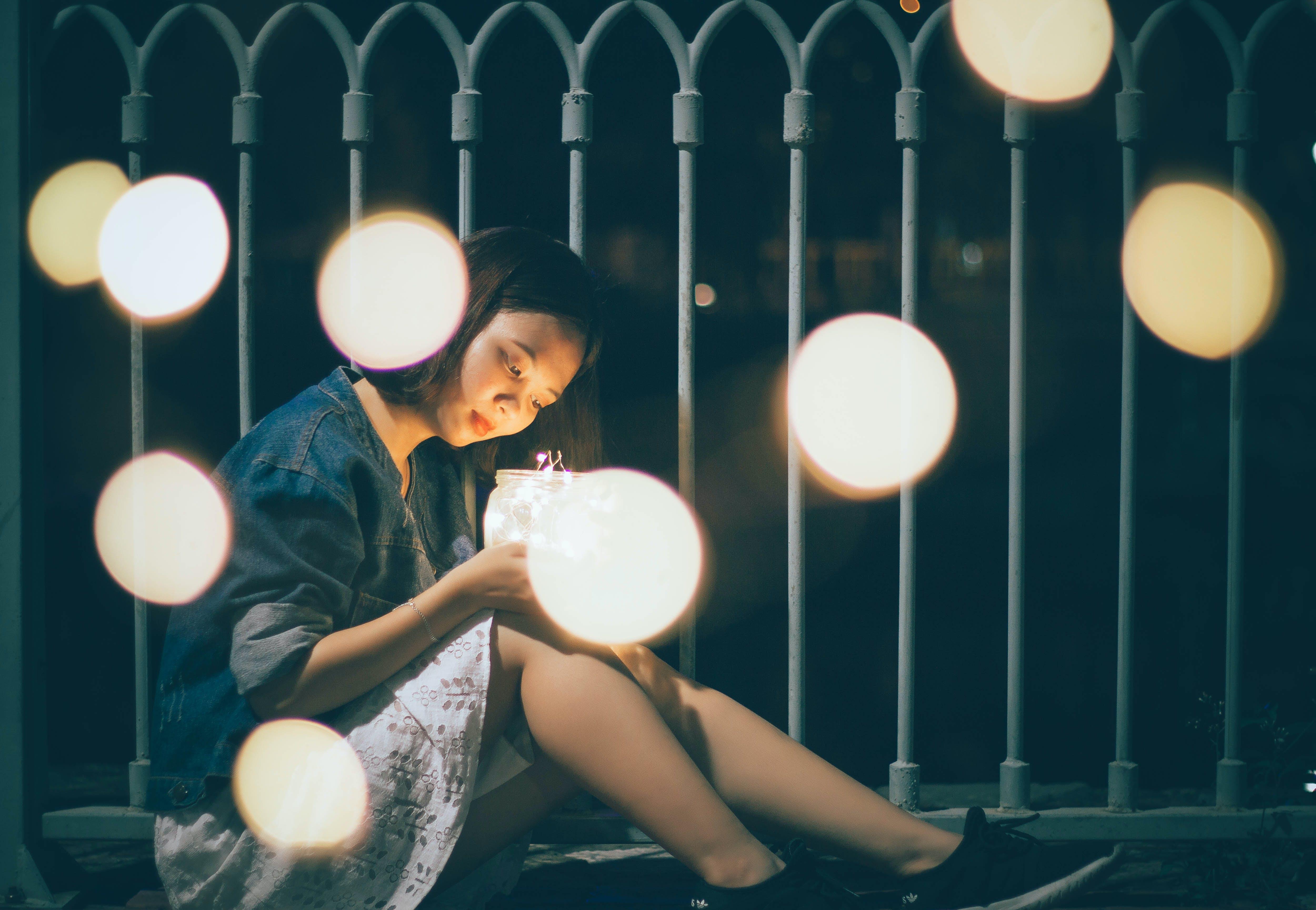 Woman Sitting Near the Rail