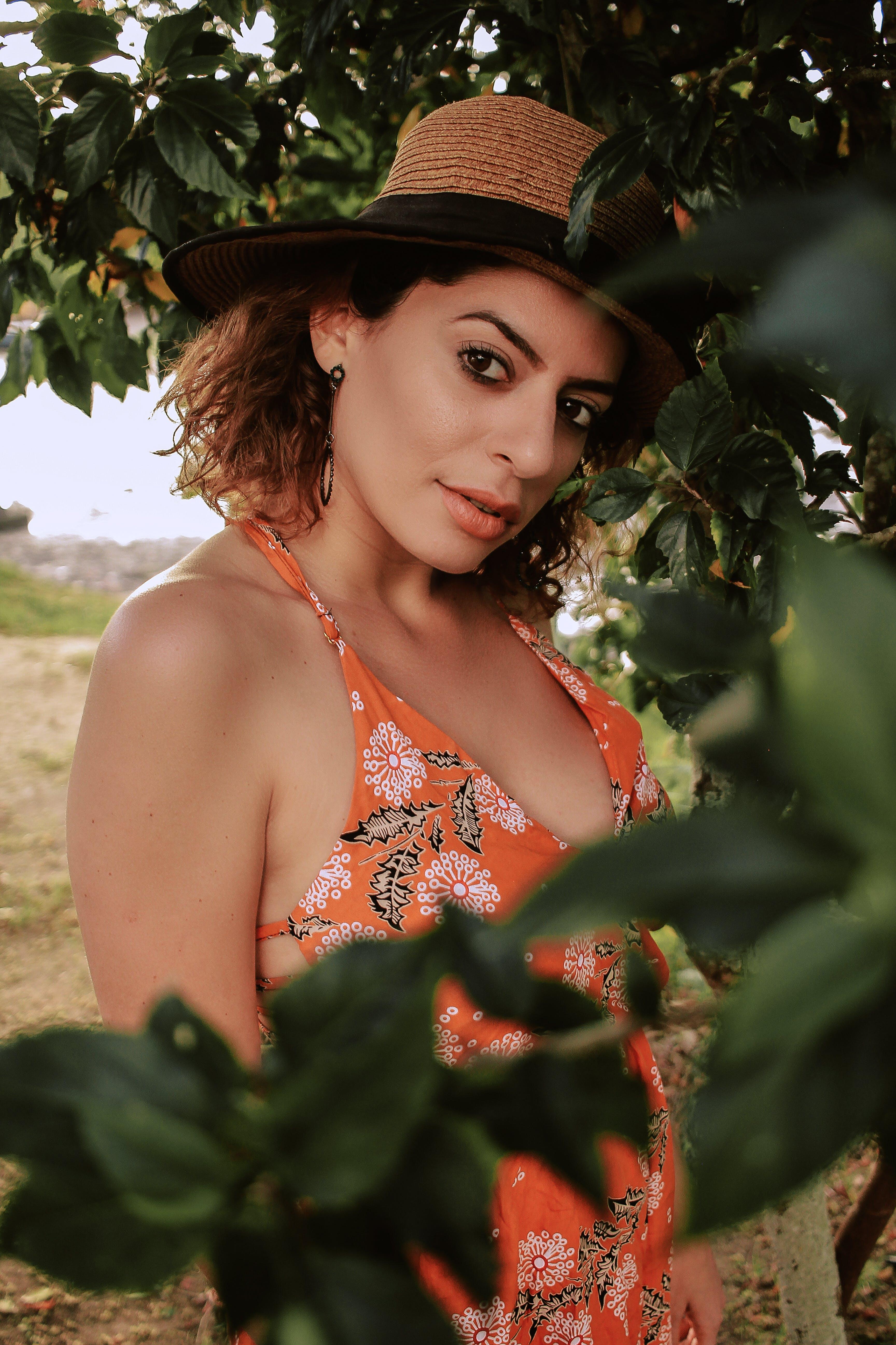 Woman Wearing Orange, Black, and White Floral Halter-neck Top