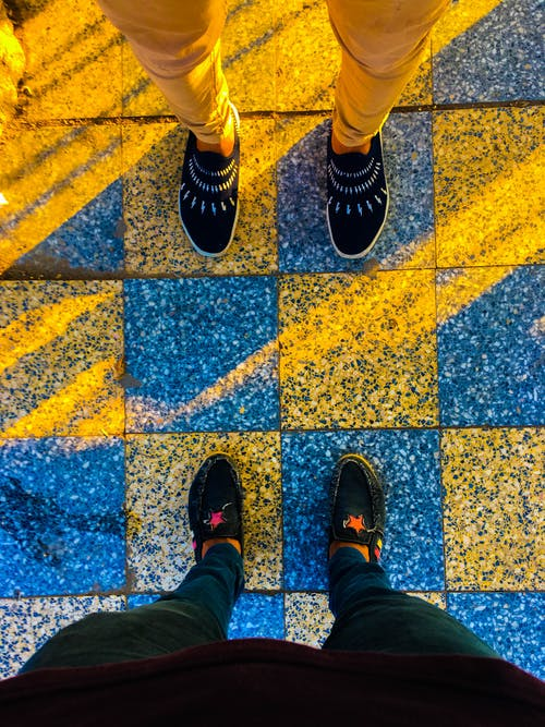Two Person Wearing Loafers on Tiles
