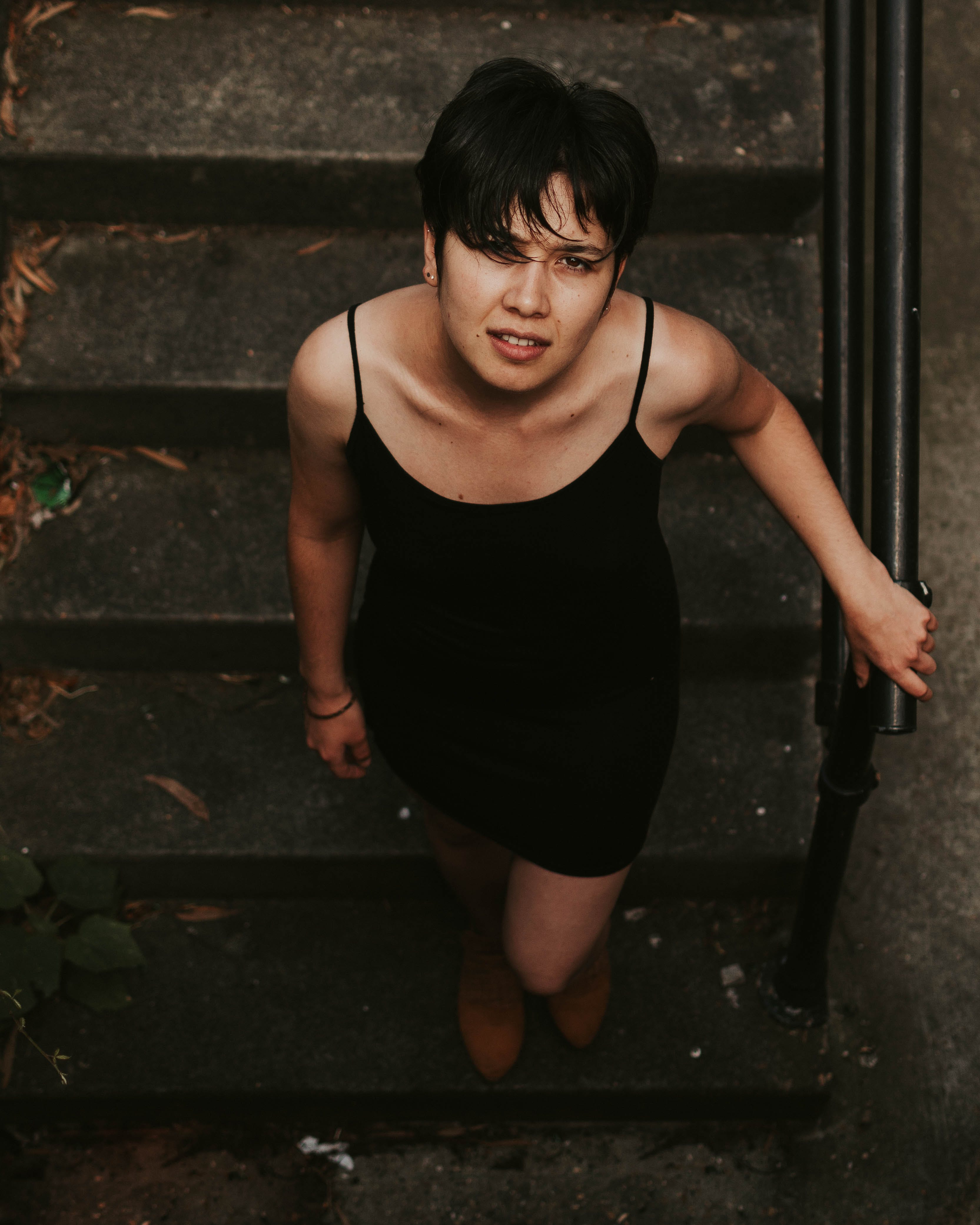 High-angle Photography of Woman on Stairs