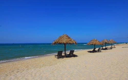 Foto profissional grátis de água, ao ar livre, areia, beira-mar