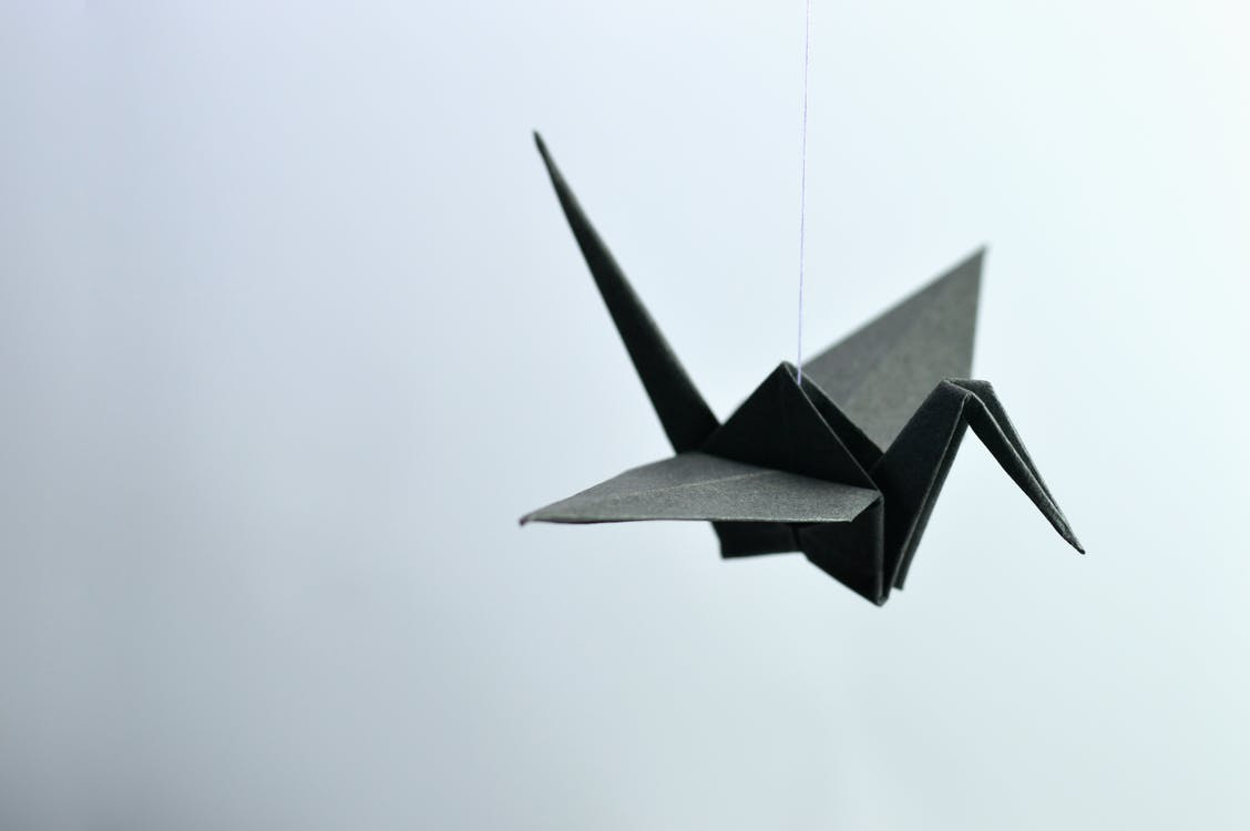 Shallow Focus Photography Of Paper Crane