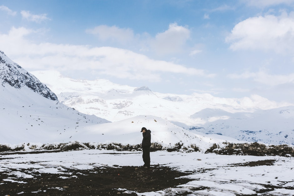 Man in Black Shirt Standing on White Snow Field
