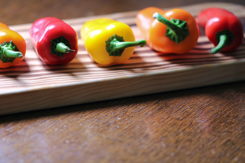 Free stock photo of chopping board, green, orange, orange pepper