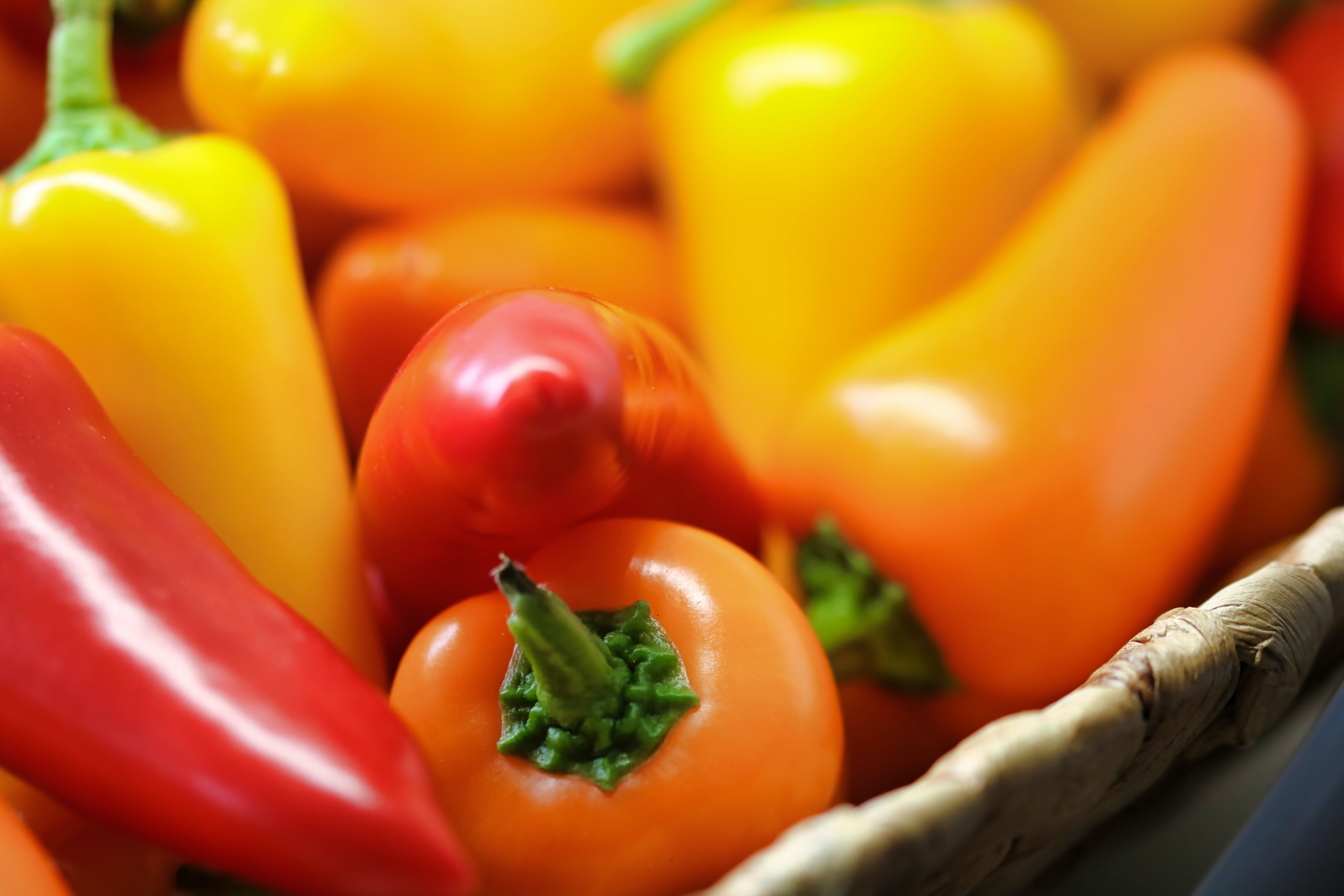 Close-up Photo of Orange and Red Bell Peppers