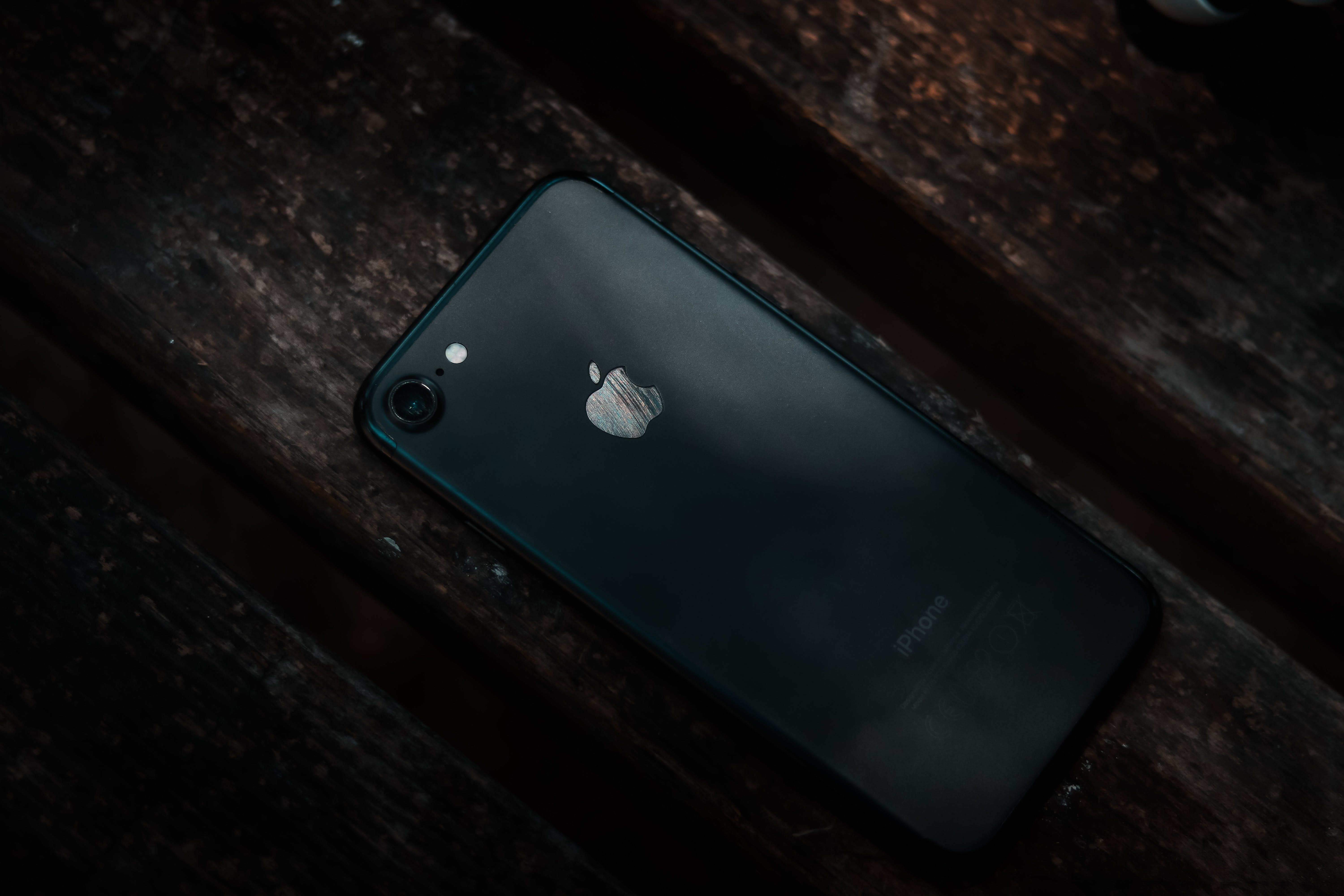 Photo of iPhone on Brown Surface