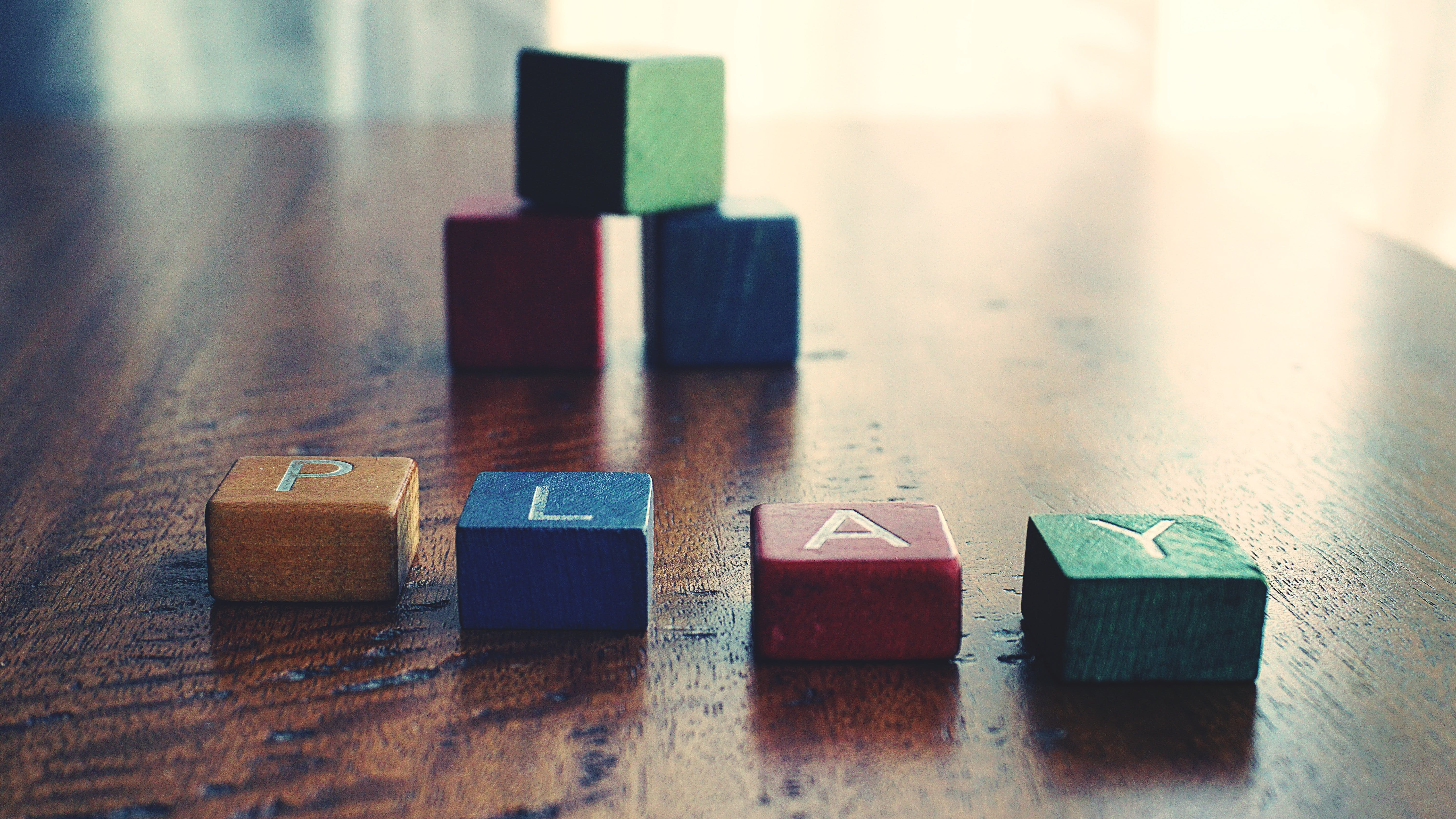"""Conceptual Photo of Word """"play"""" Spelled by wooden Blocks."""