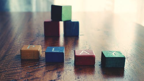 "Conceptual Photo of Word ""play"" Spelled by wooden Blocks."