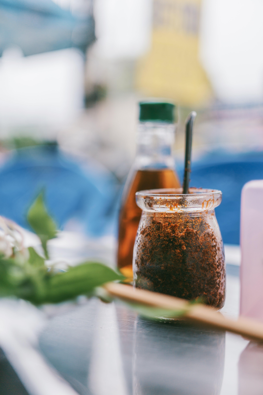 Kostenloses Stock Foto zu container, drinnen, glas, glasartikel