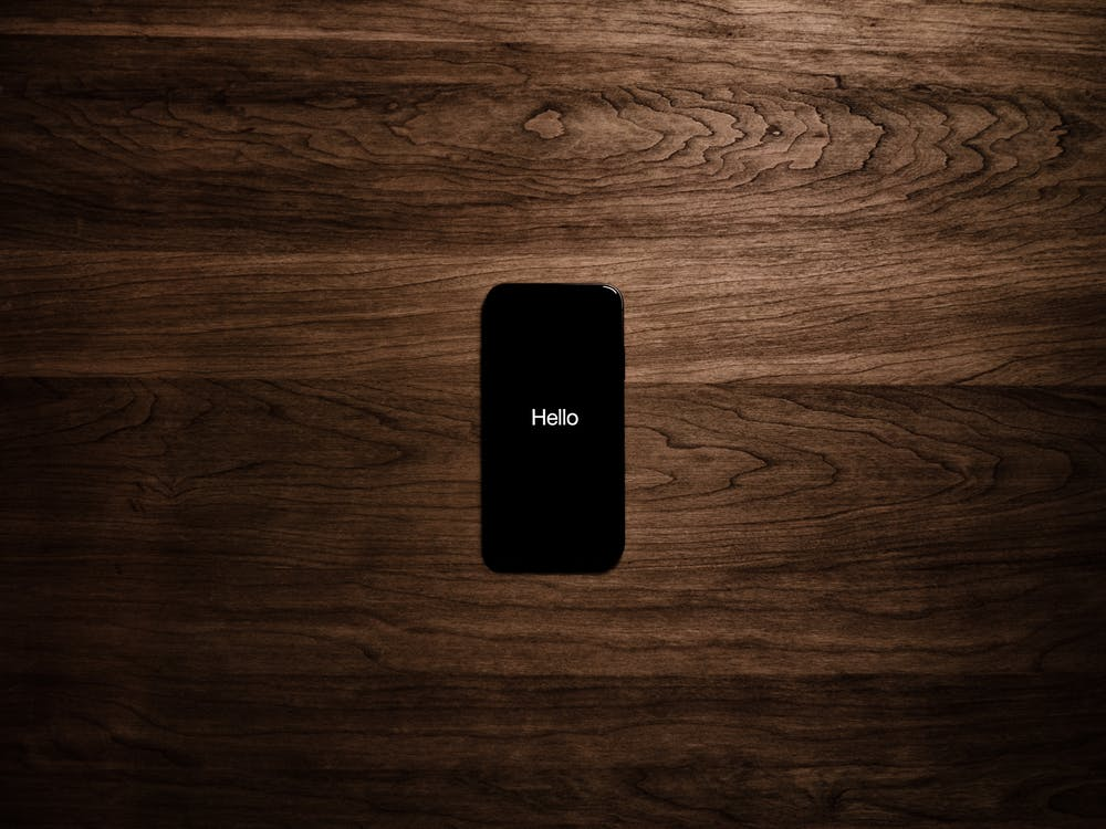 Turned on Black Iphone 7 Displaying Hello